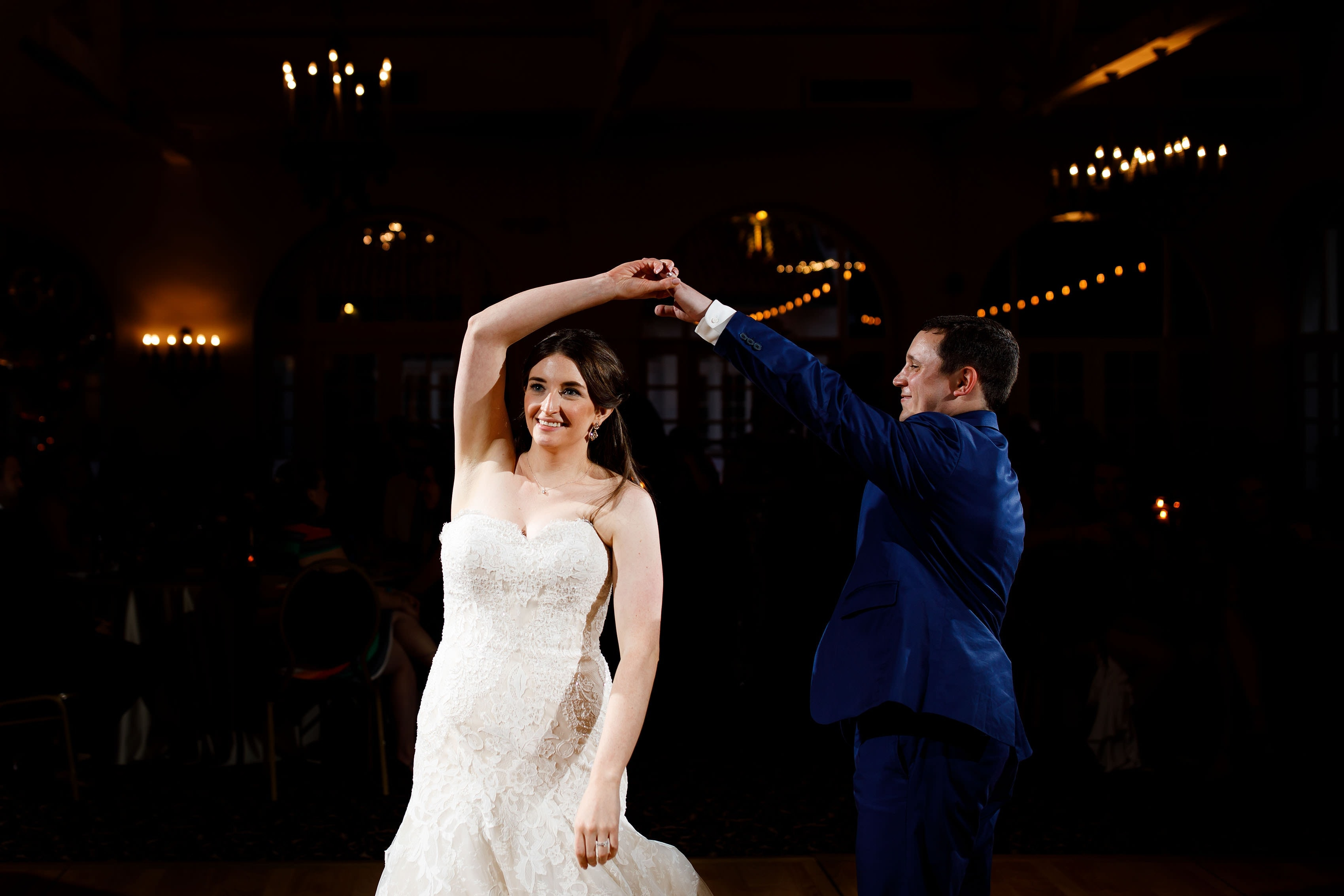 The groom spins the bride during their first dance at Ravisloe Country Club