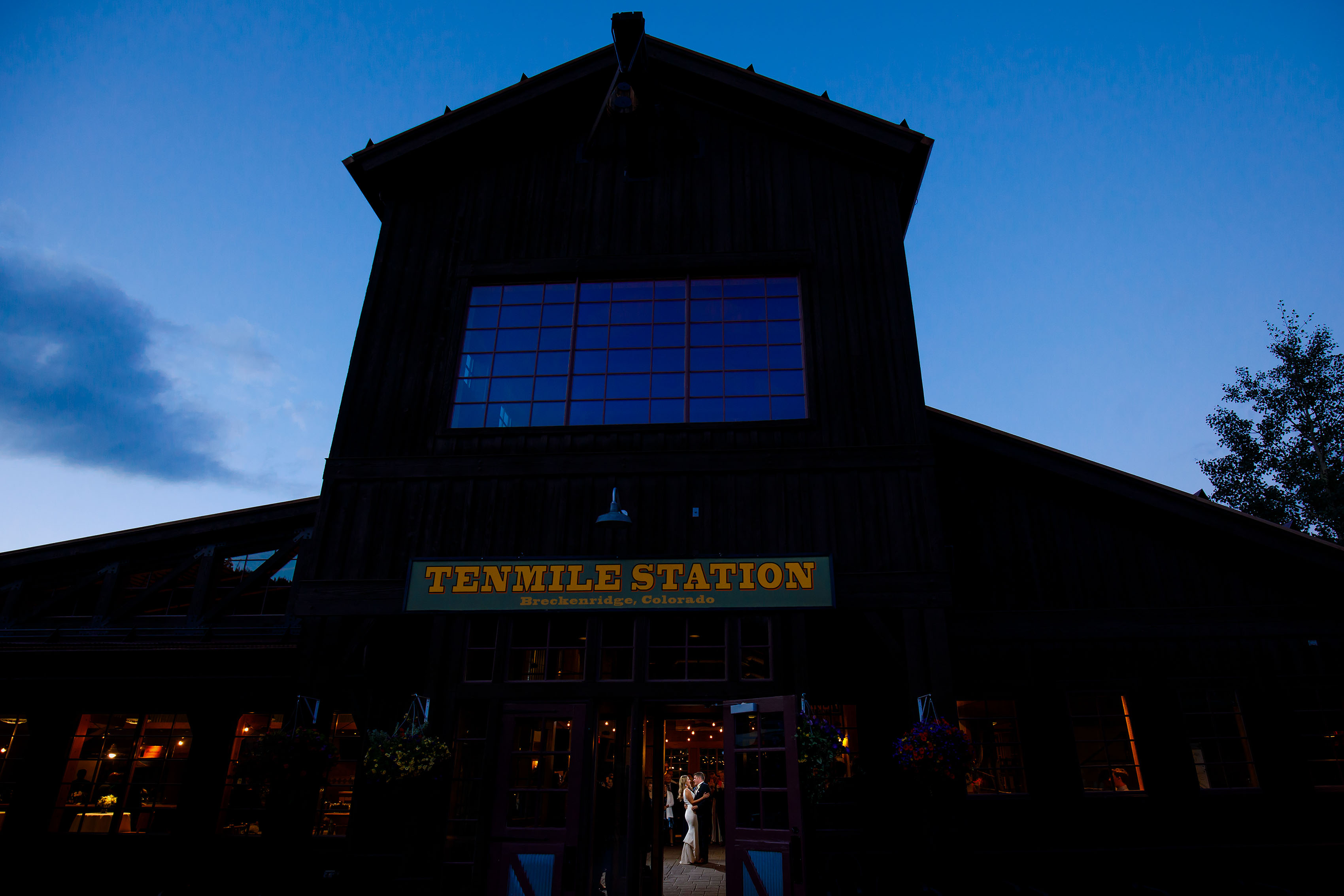 The couple share their first dance during their wedding at TenMile Station on Peak 9 in Breckenridge