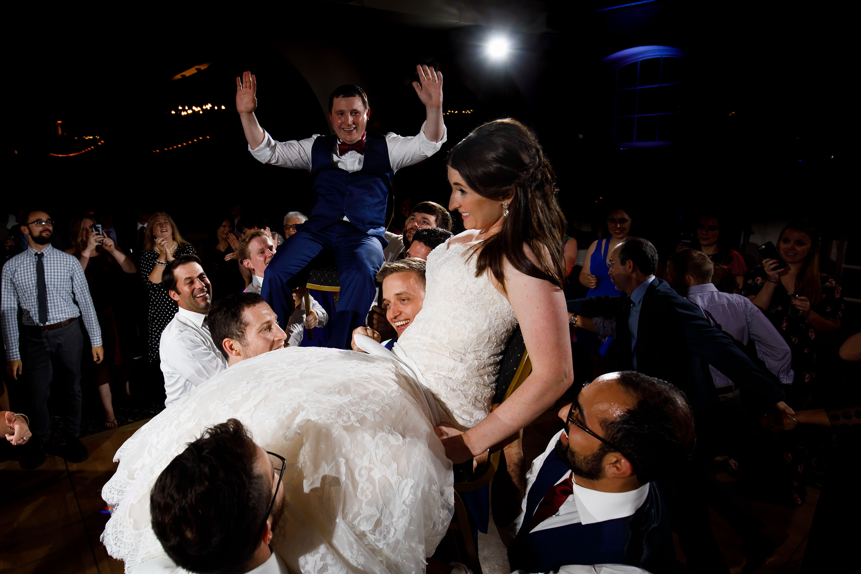 The bride and groom during the hora at Ravisloe Country Club