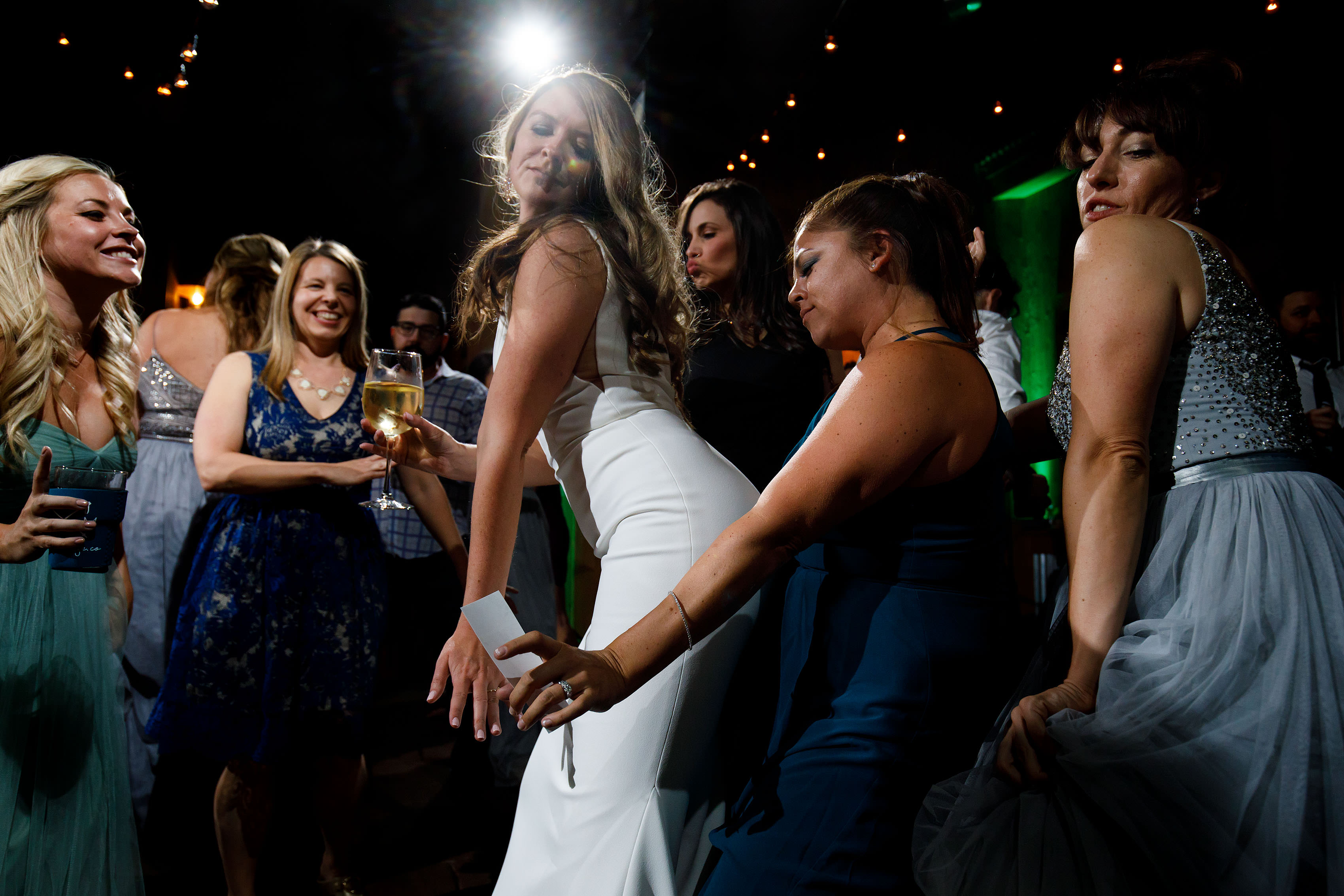 Heather dances with friend during her wedding at TenMile