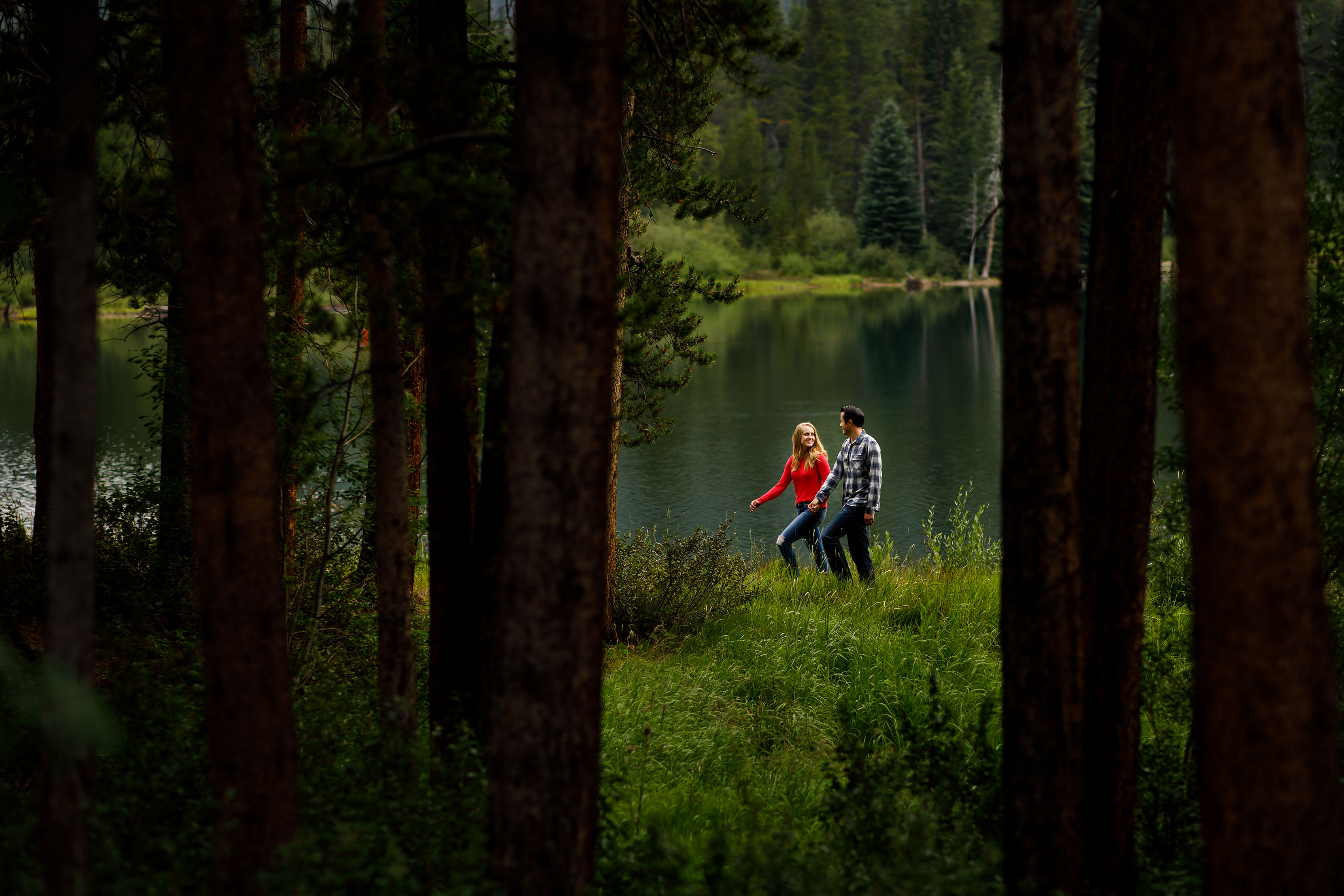 A couple walk together on a trail during their engagement session at Officer's Gulch