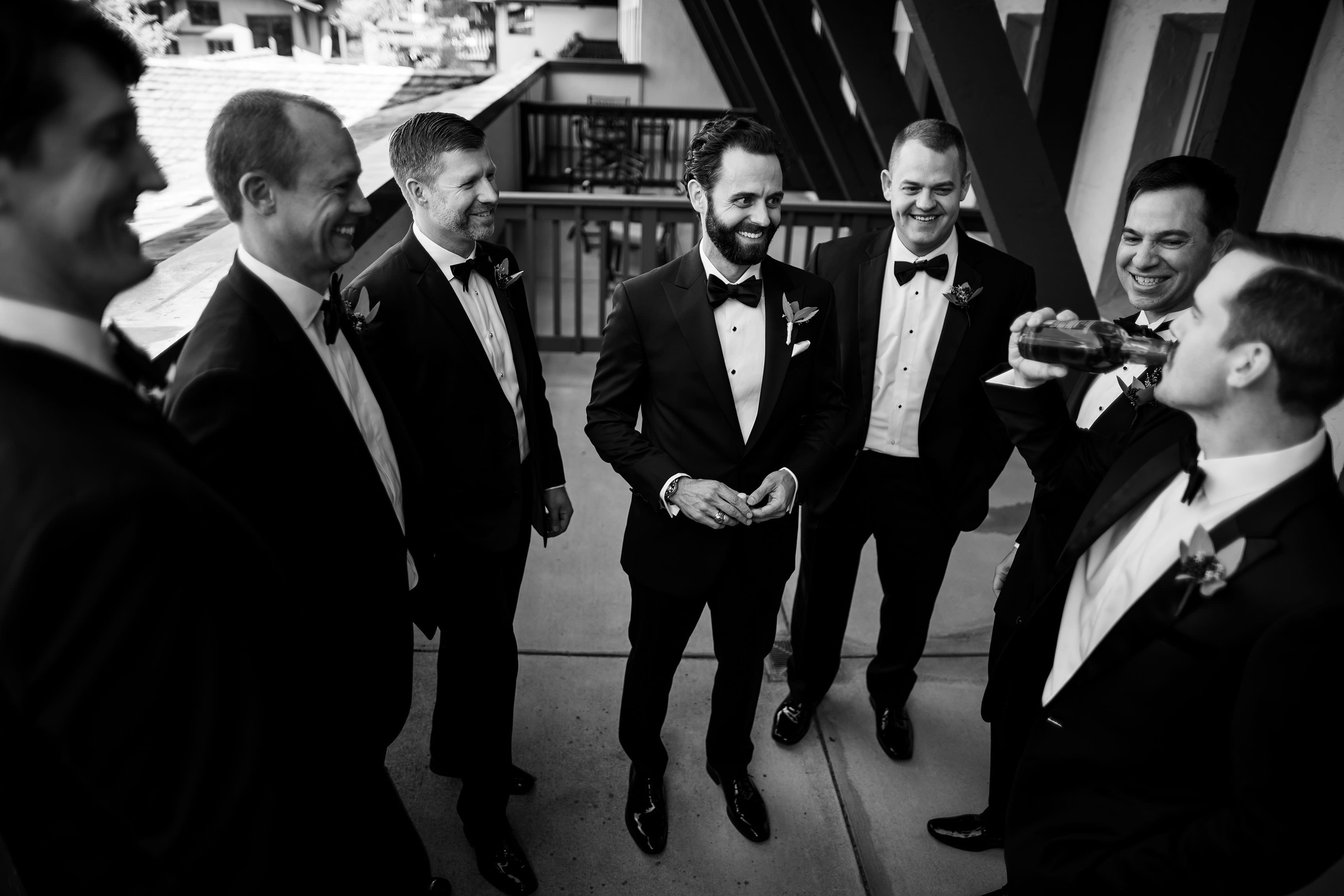 Groomsmen share a drink at the lodge at vail