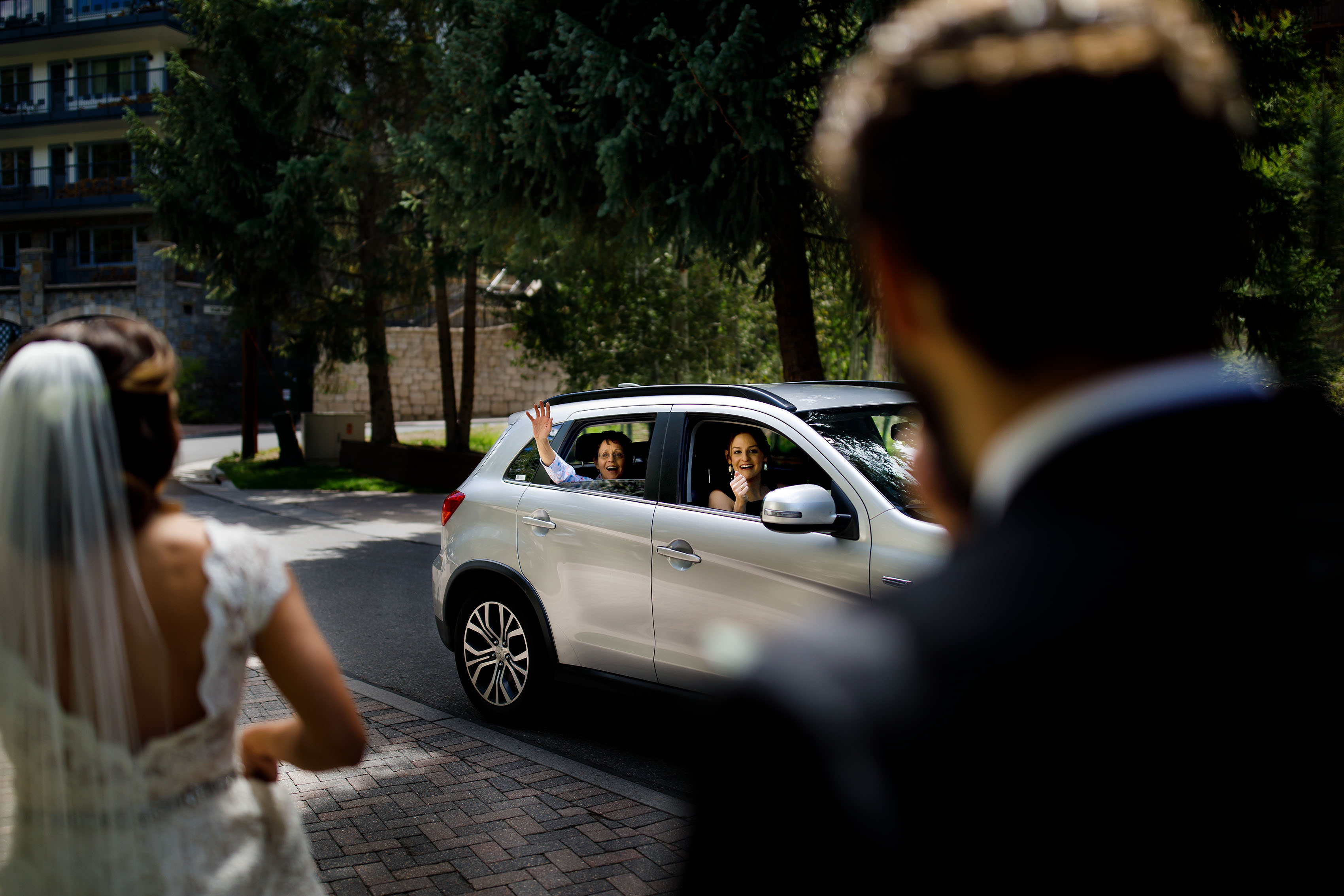 Guests wave at the couple on their wedding day