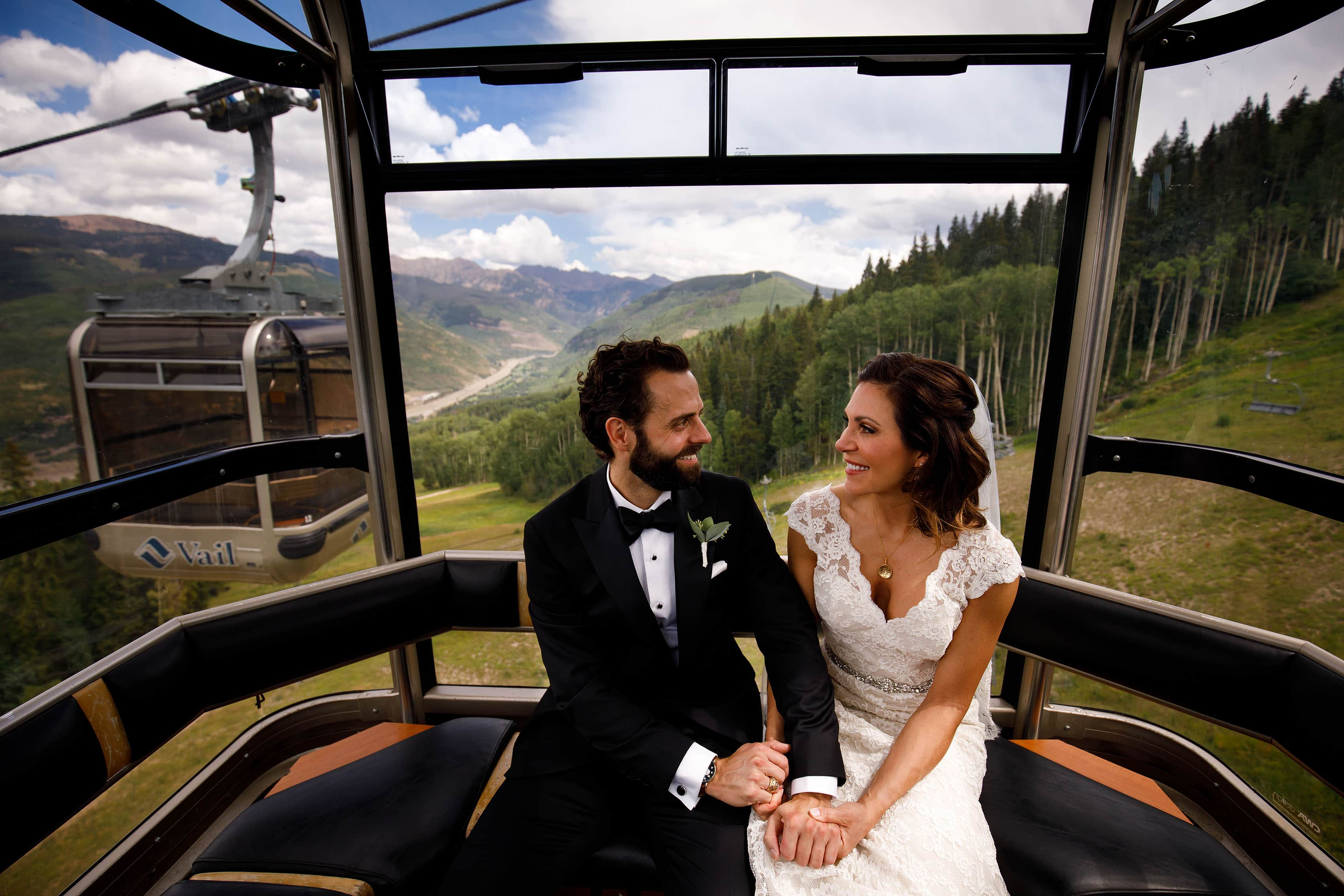 The couple ride the Lionshead gondola at Vail on their wedding day