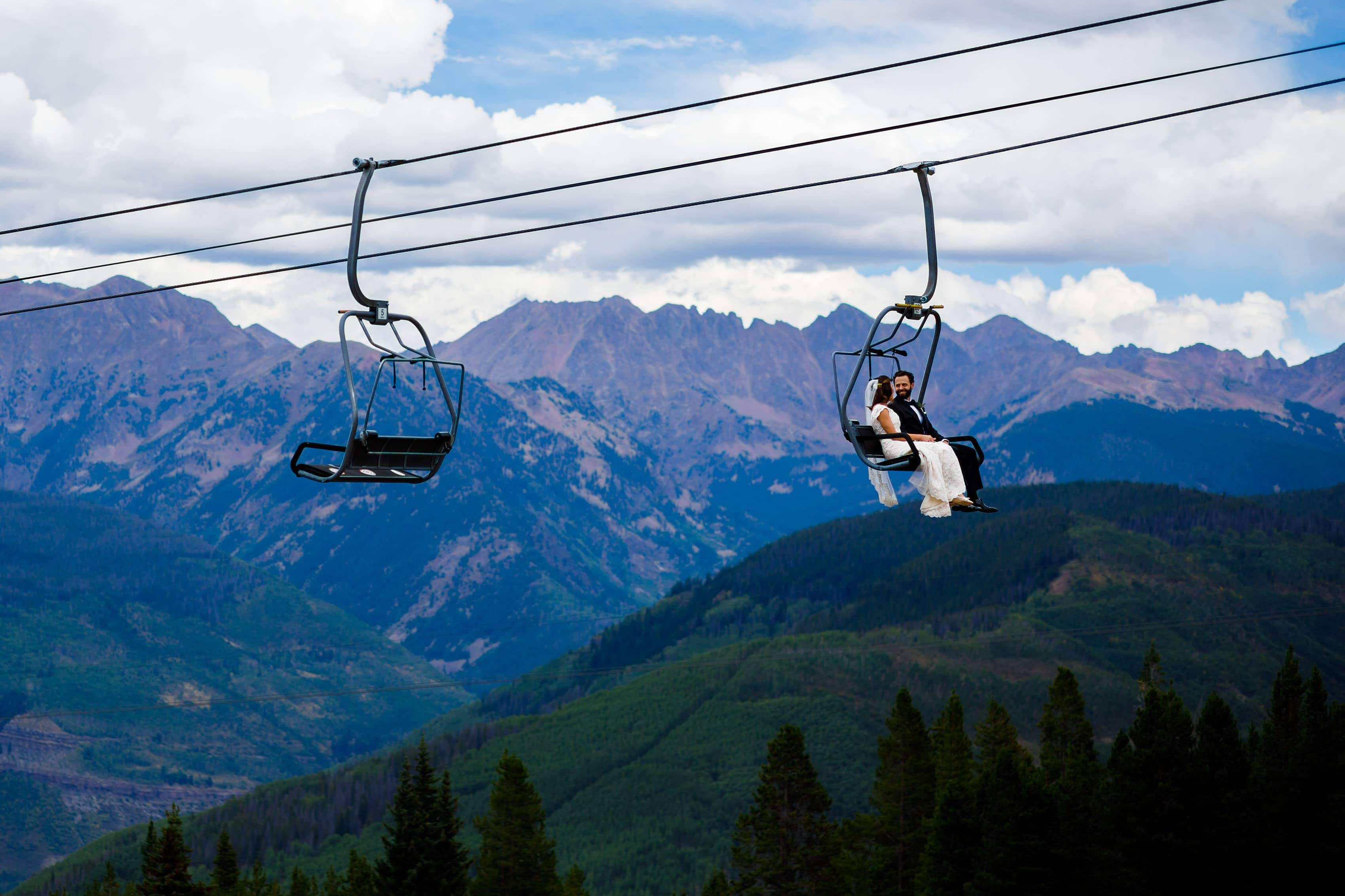 The bride and groom ride the Vail chairlift