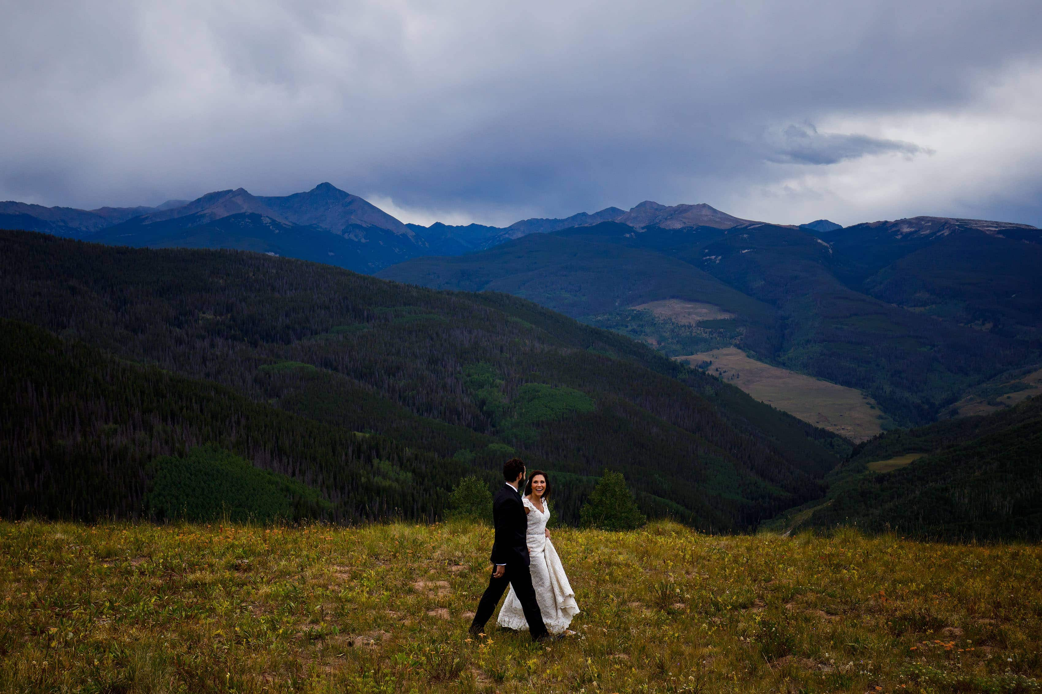Christine and Stephen walk together atop Vail mountain before their Vail Golf Club wedding