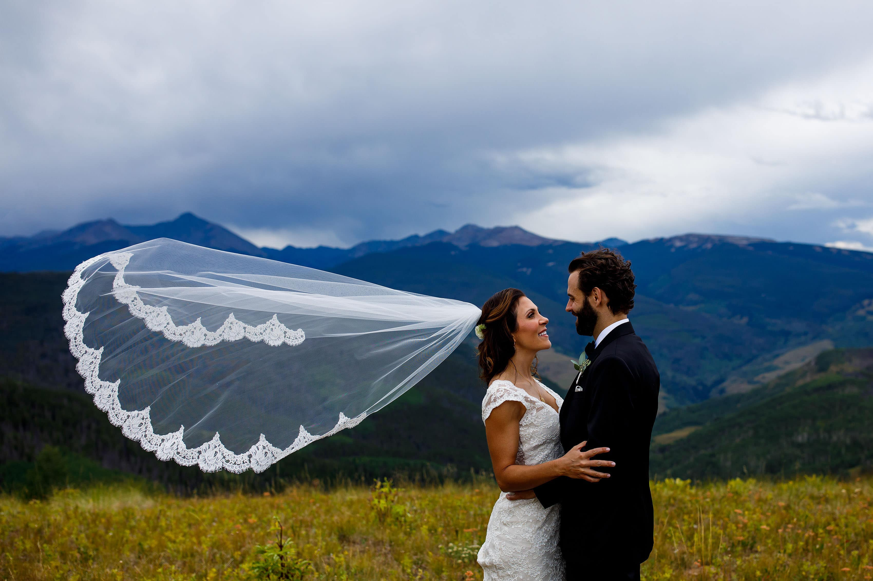 Christine and Stephen pose together atop Vail mountain before their Vail Golf Club wedding