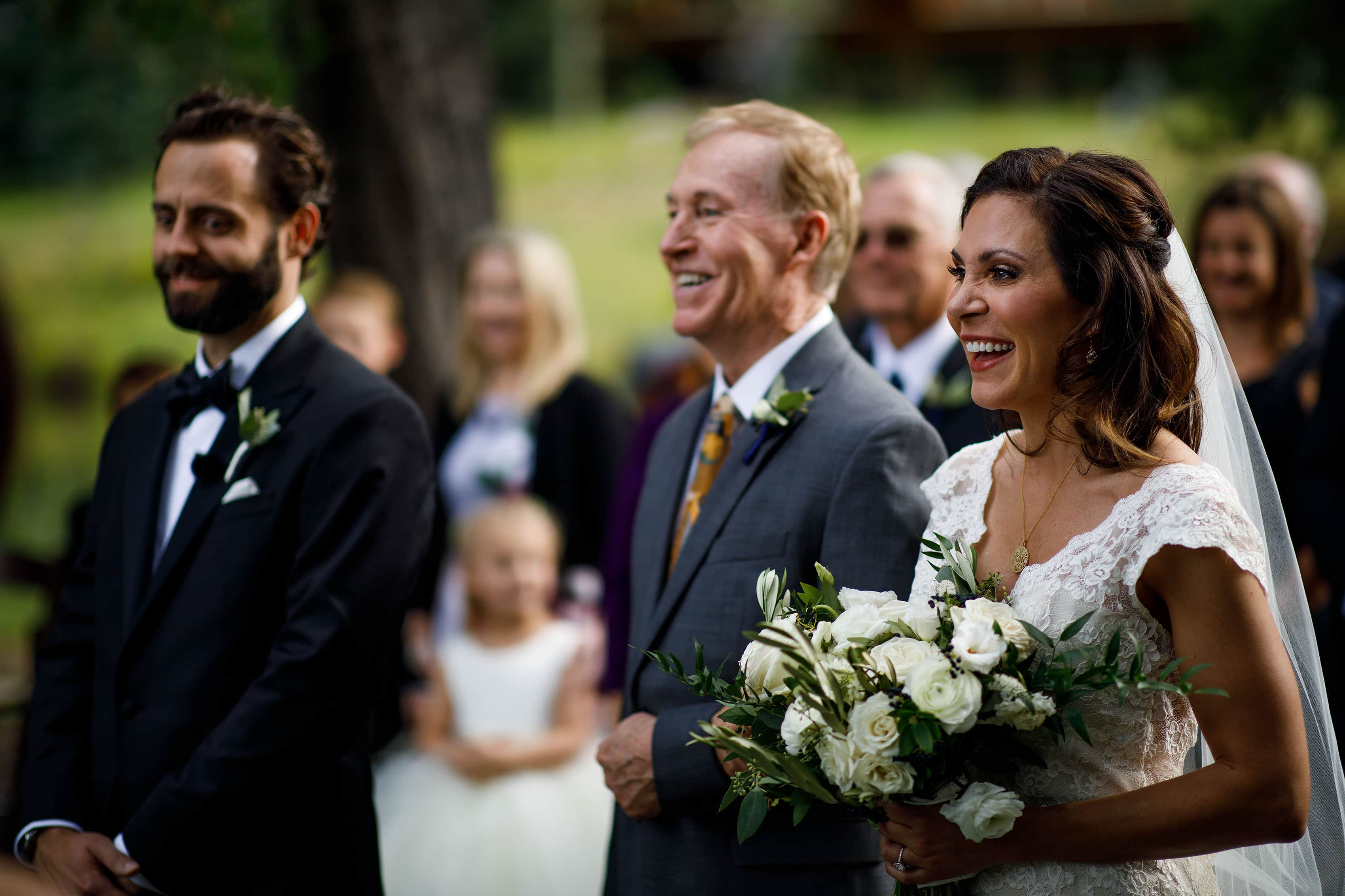The couple share a laugh during their wedding in Vail