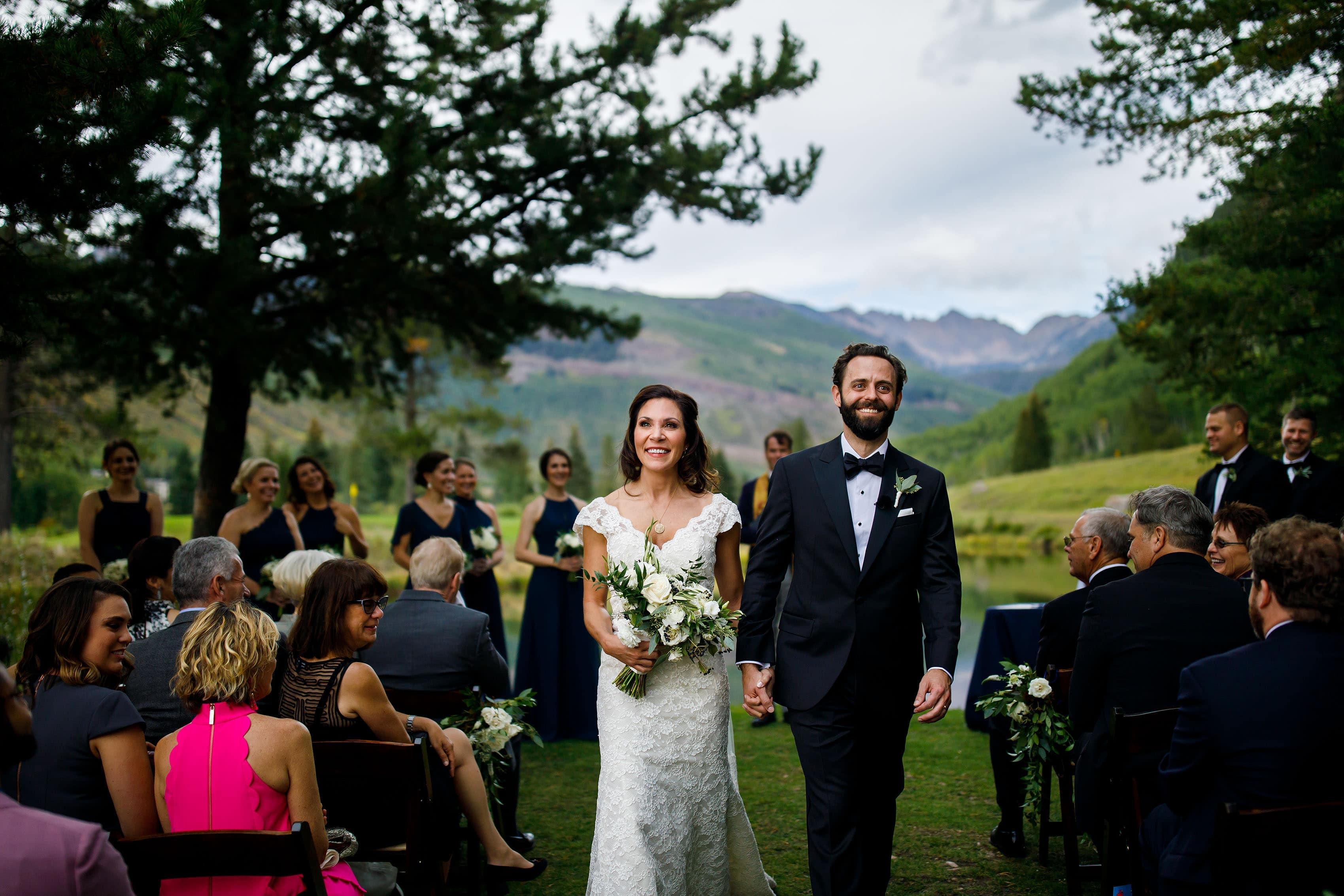 The bride and groom celebrate after their summer Vail Golf Club wedding