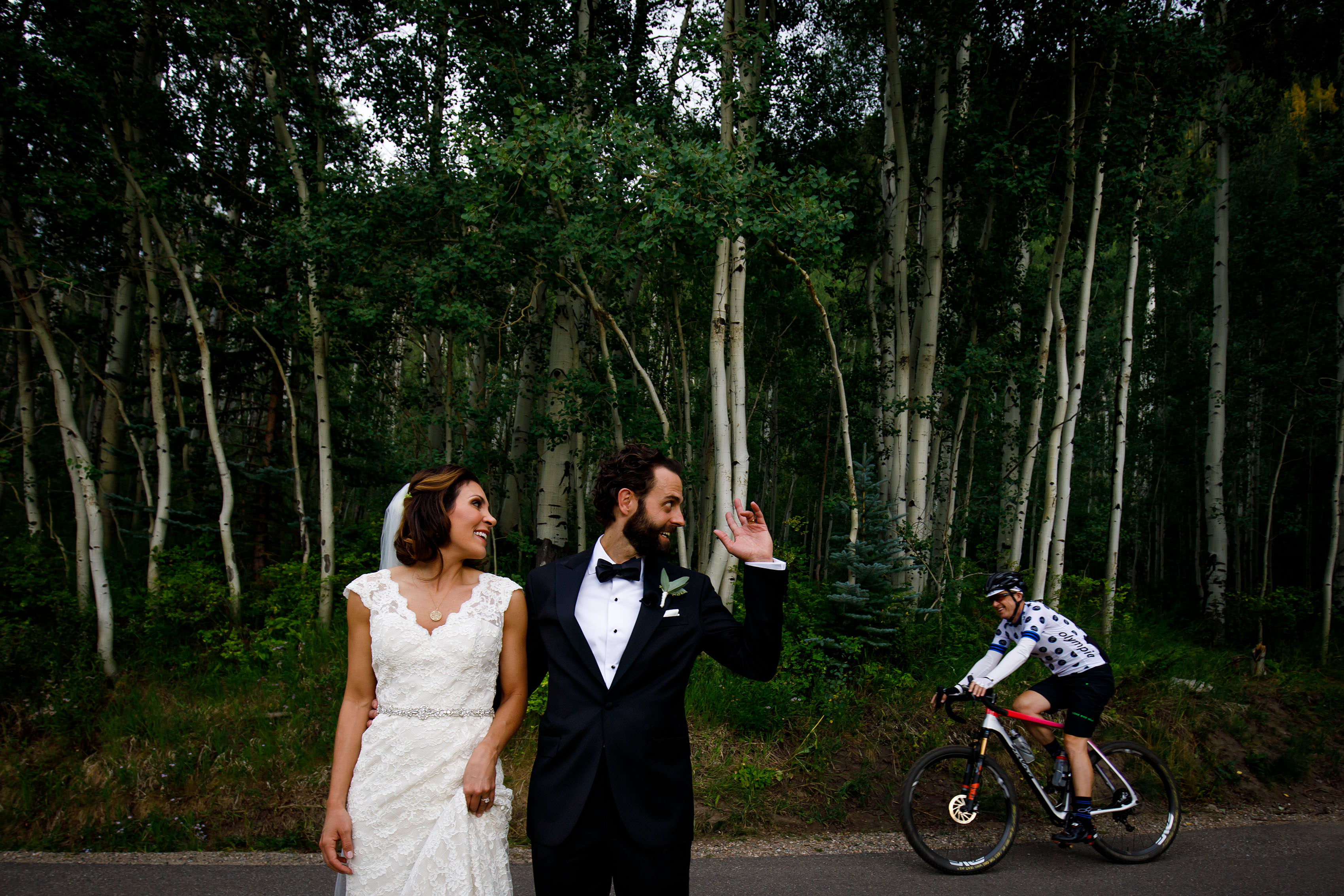 Christine and Stephen wave at a cyclist