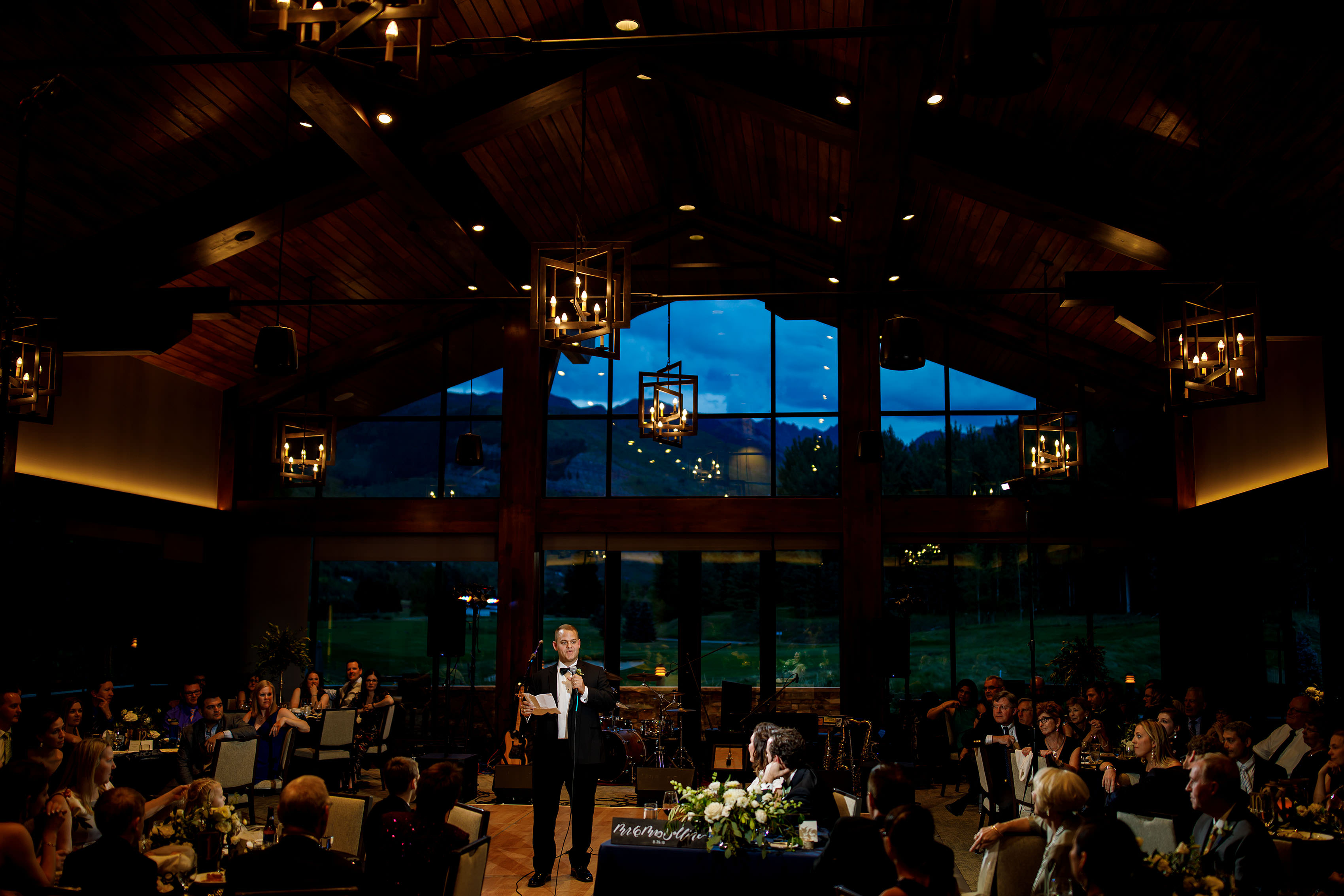 The best man give a toast inside the reception space during a Vail Golf Club wedding in August