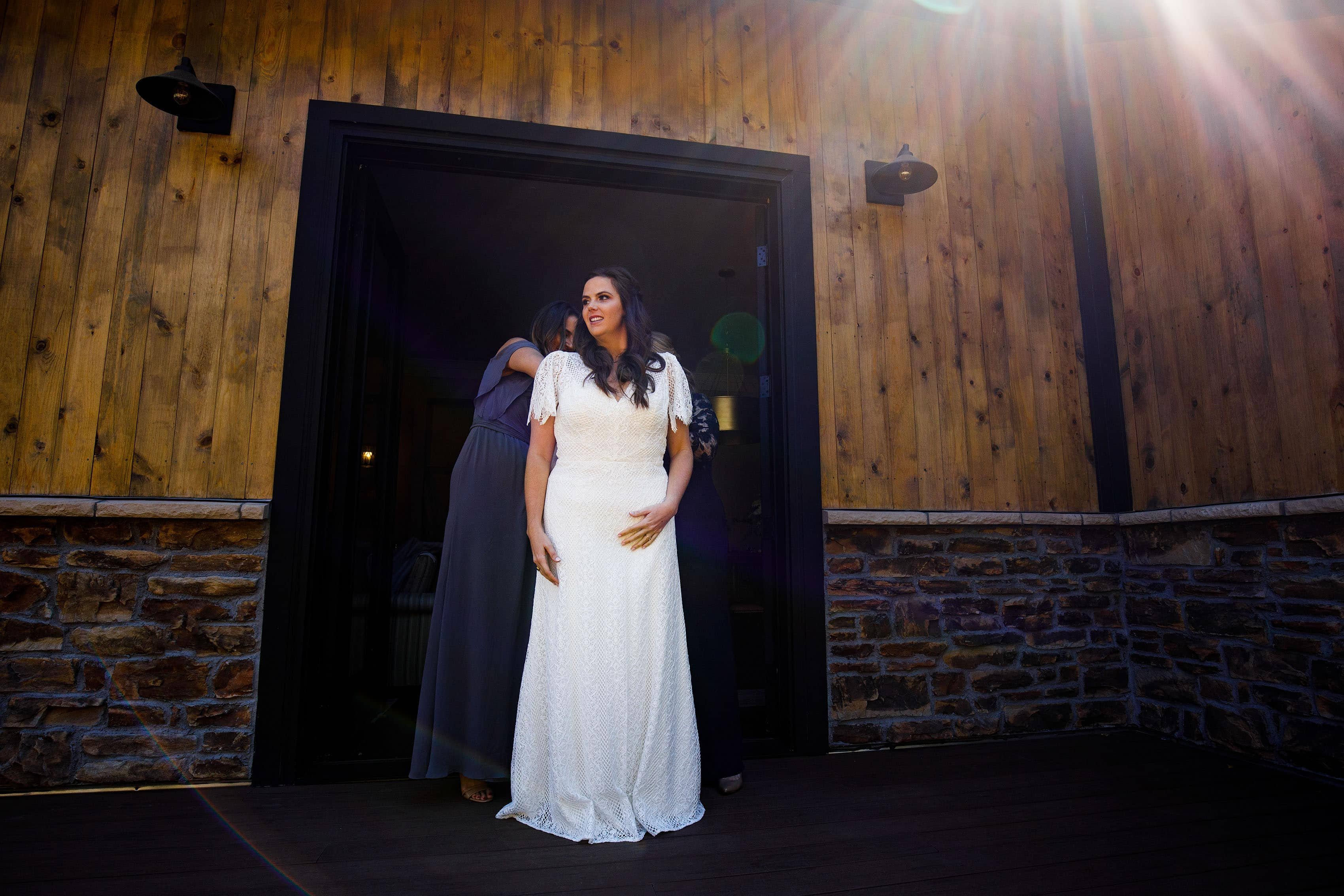 Kate puts on her wedding dress in the bridal suite at Blackstone Rivers Ranch