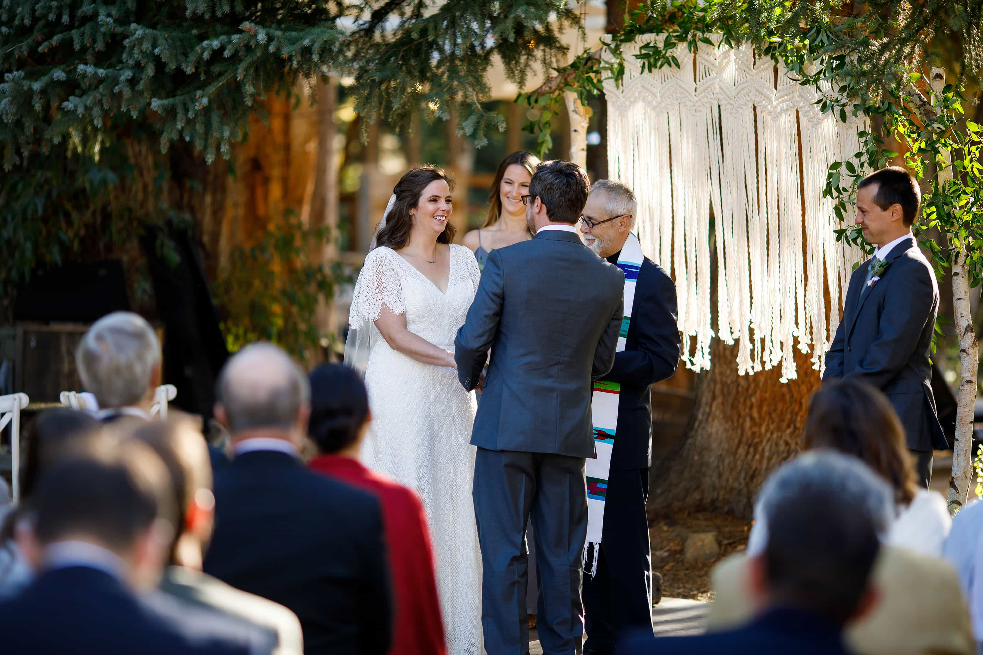 Kate smiles during the wedding ceremony in Idaho Springs