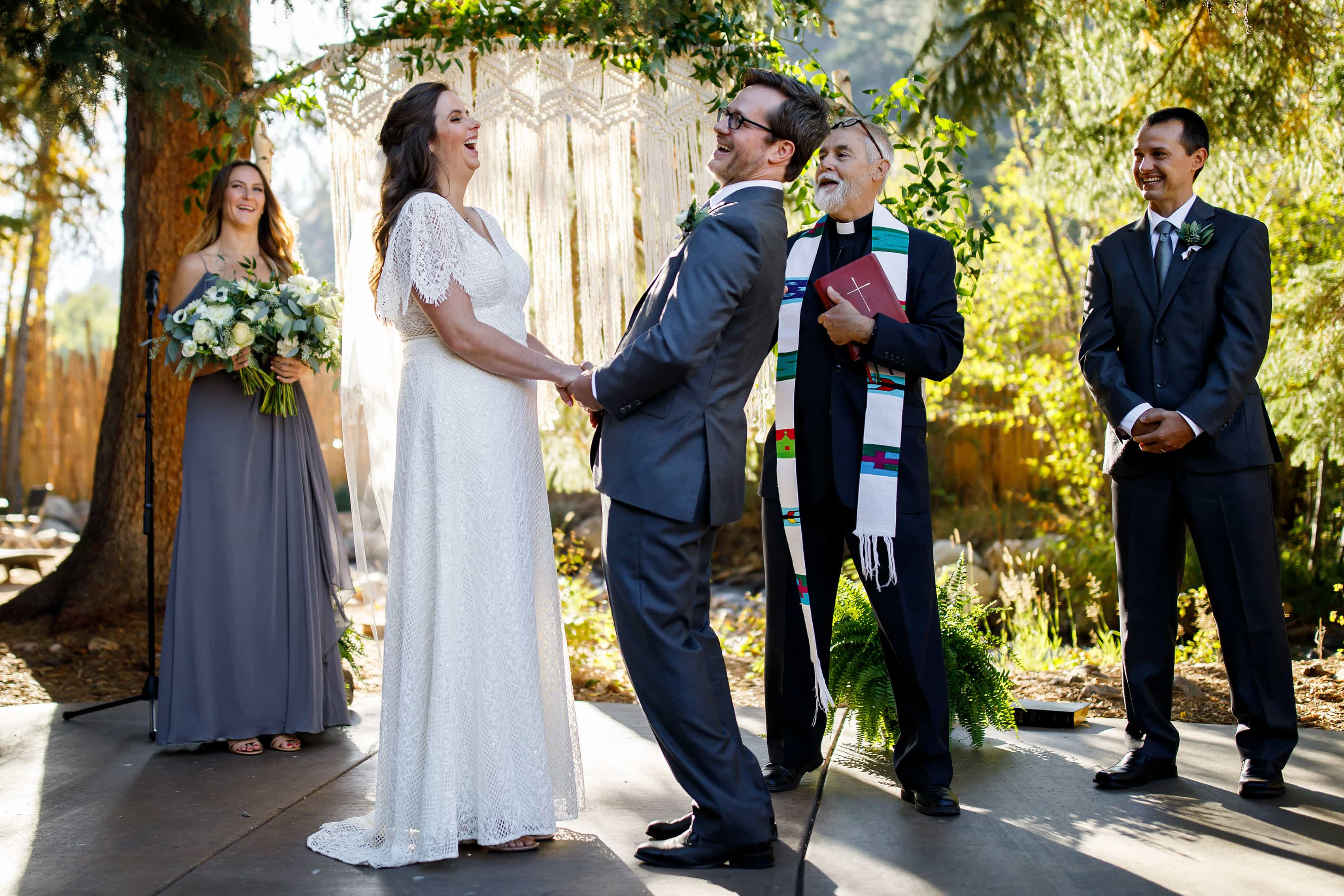 The newlyweds share a laugh during their fall Blackstone Rivers Ranch wedding ceremony