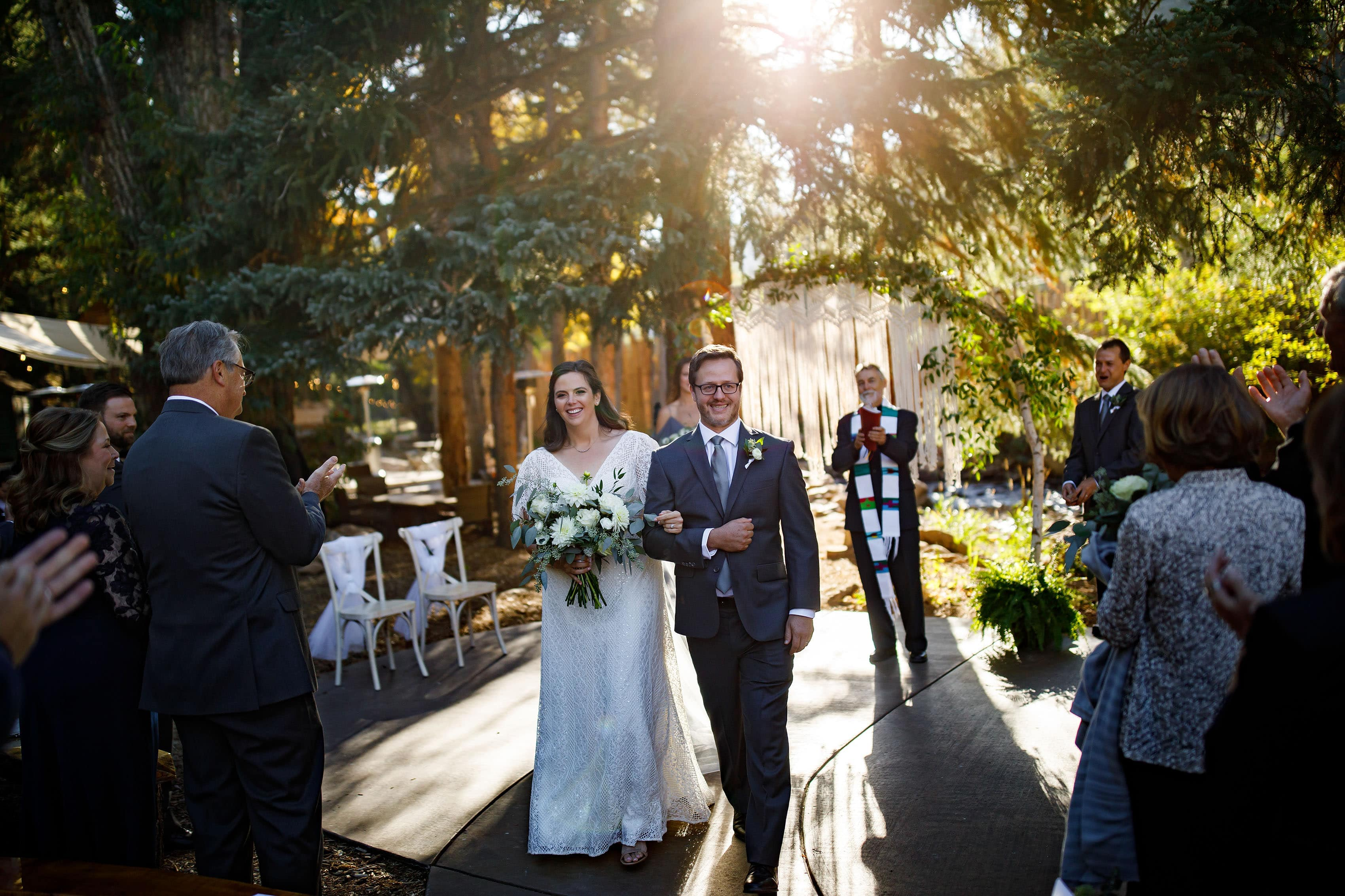 Kate and Brian celebrate after their fall wedding ceremony at Blackstone Rivers Ranch