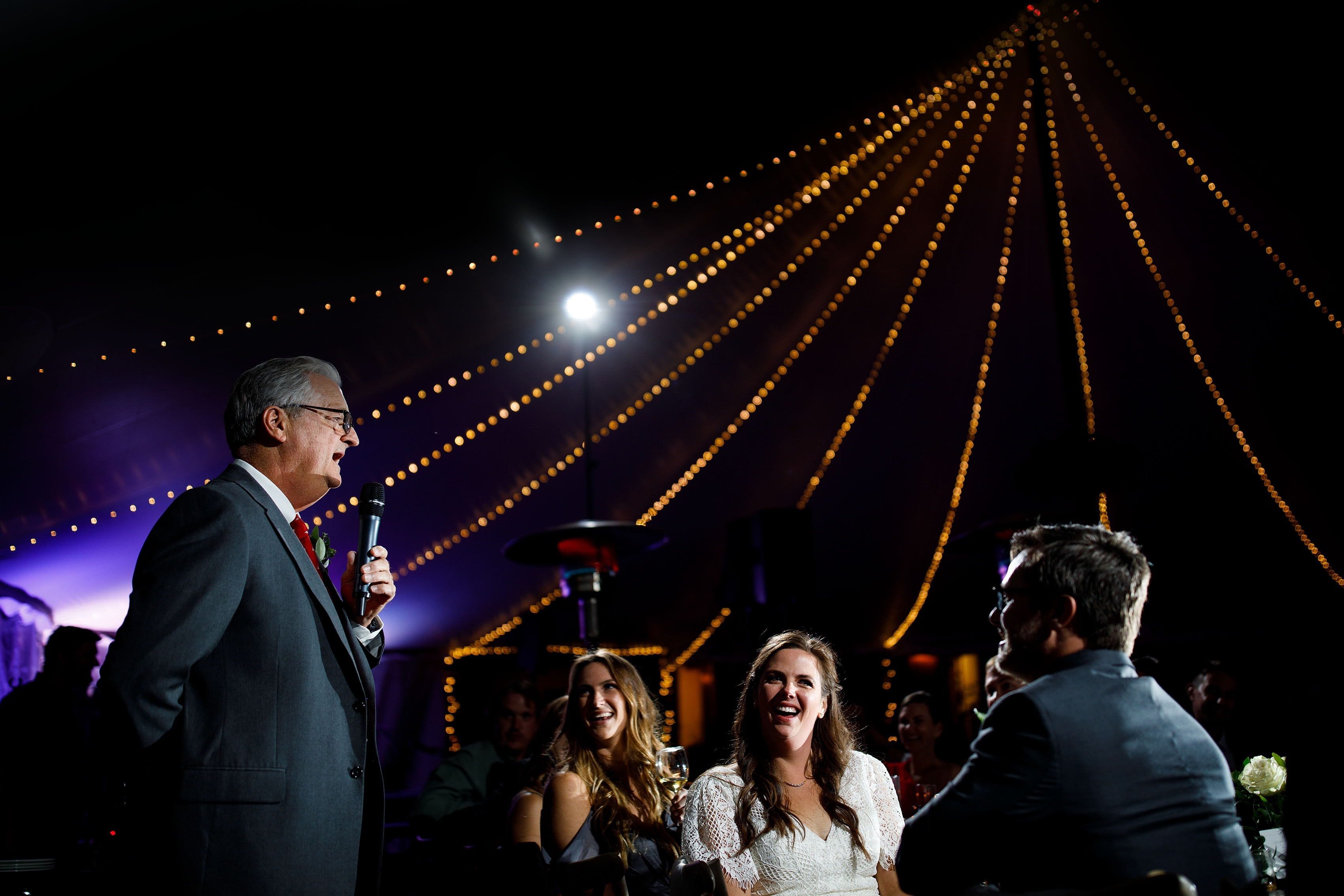 The father of the bride gives a toast under the tent during the Blackstone Rivers Ranch wedding reception in Idaho Springs