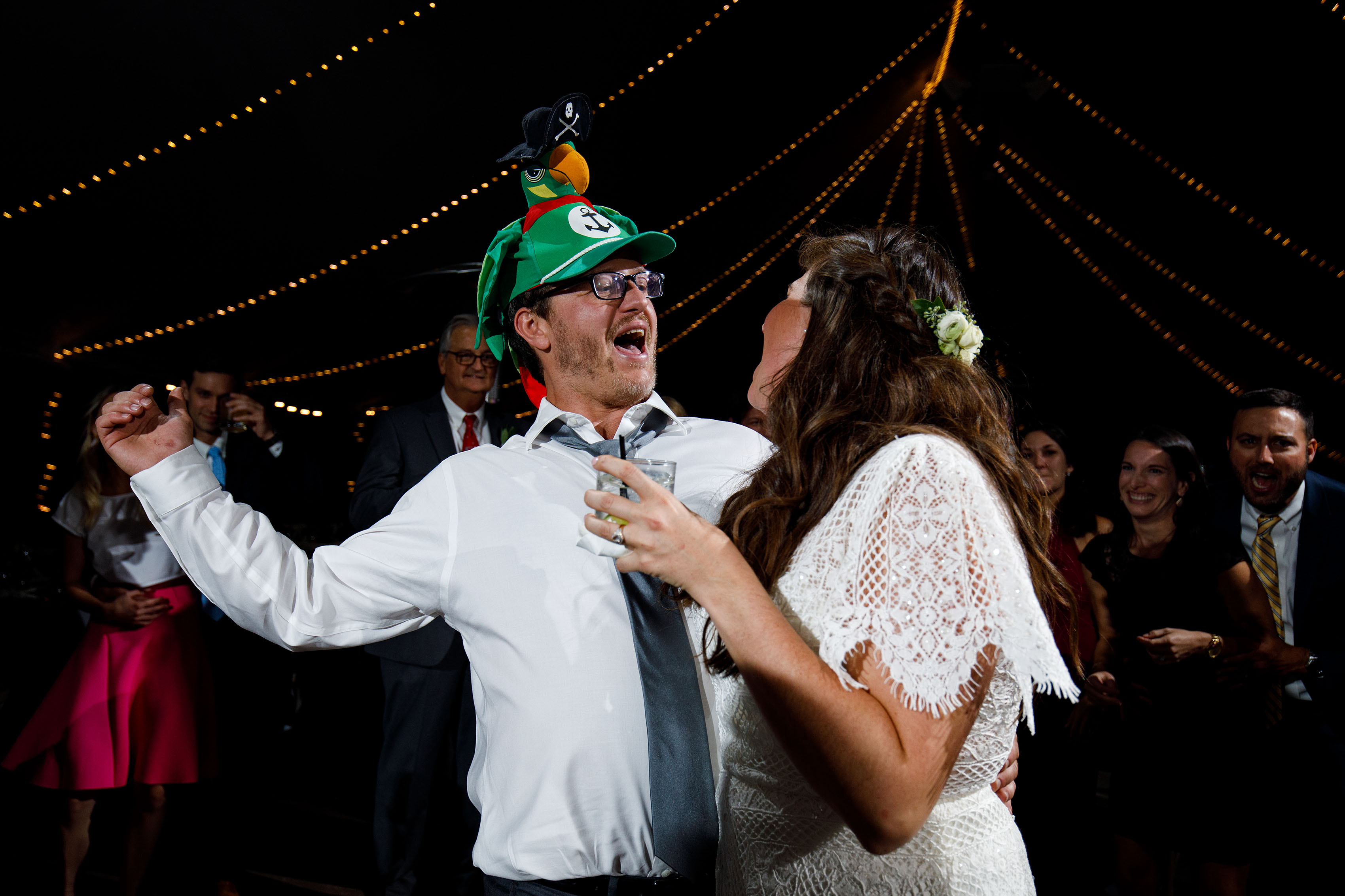 The groom and bride dance with guests during their fall wedding at Blackstone Rivers Ranch