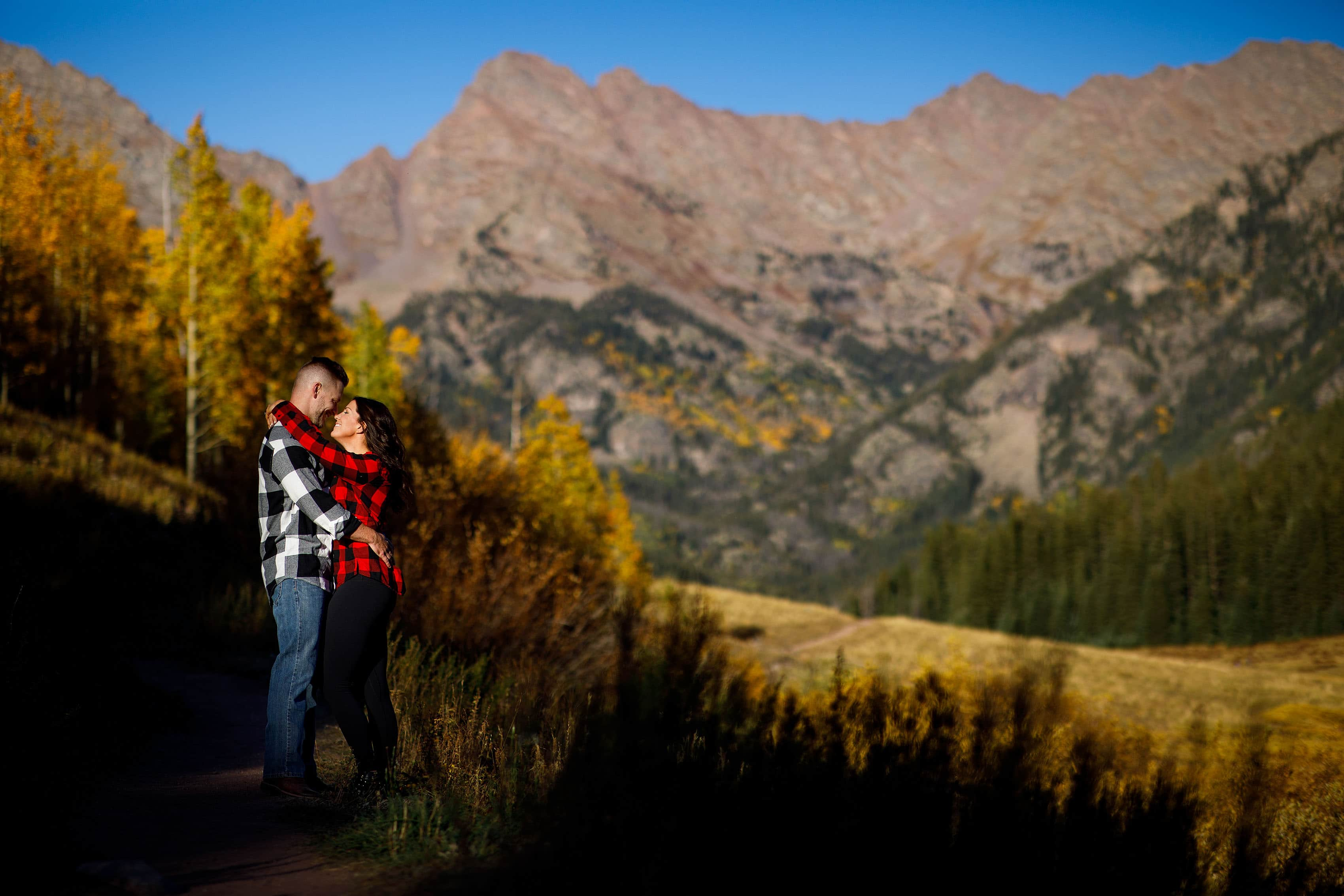 A couple pause on the trail during the fall at Piney River Ranch
