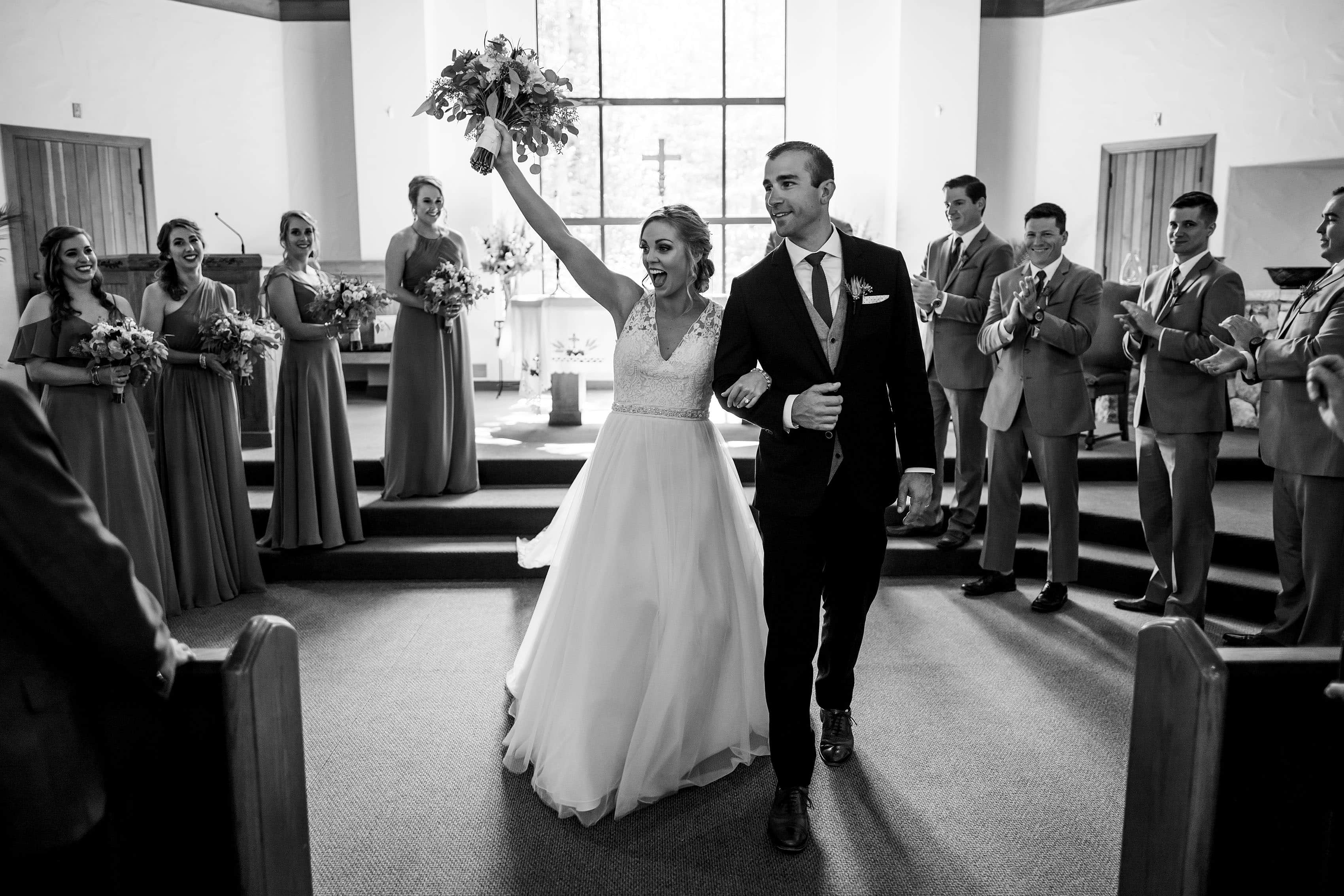 A couple celebrate during their mountain wedding at the Chapel at Beaver Creek