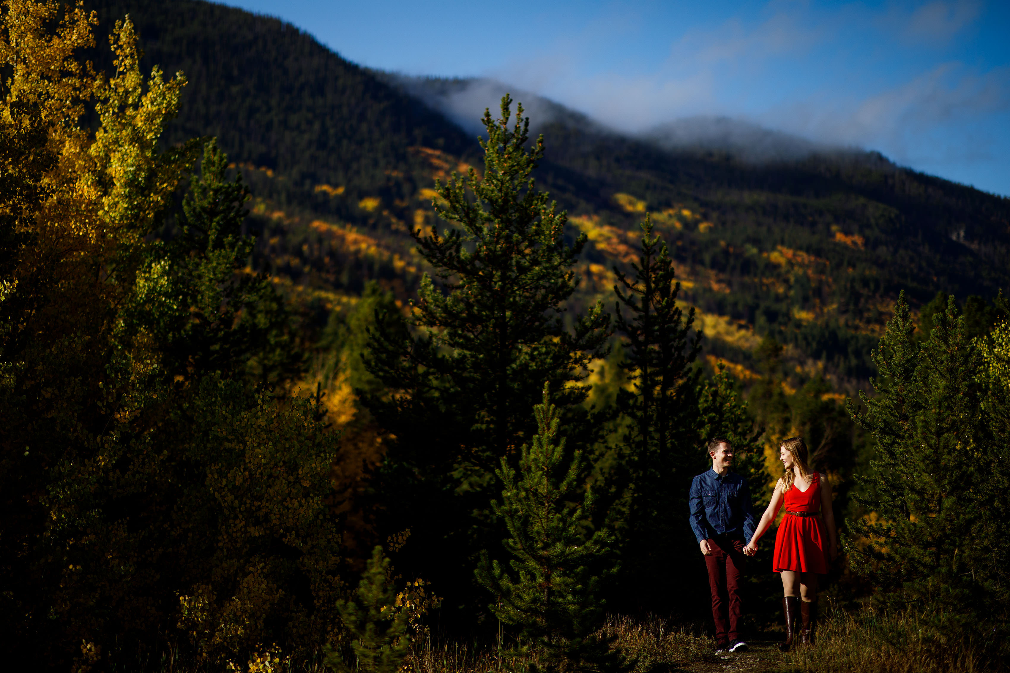 A couple walk together in the fall near Copper Mountain