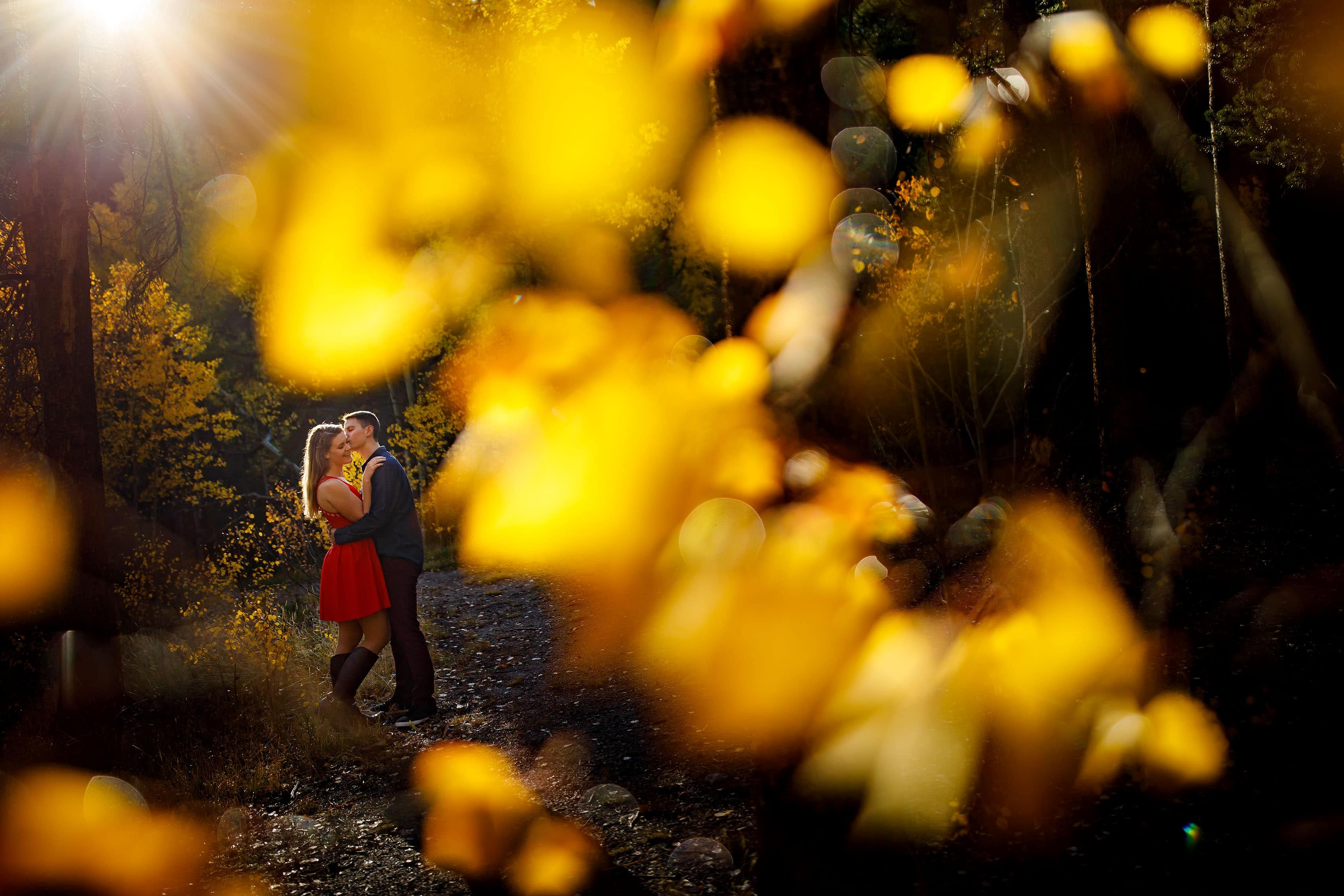 Hayden kisses Holly during their fall mountain engagement photos near Frisco Colorado