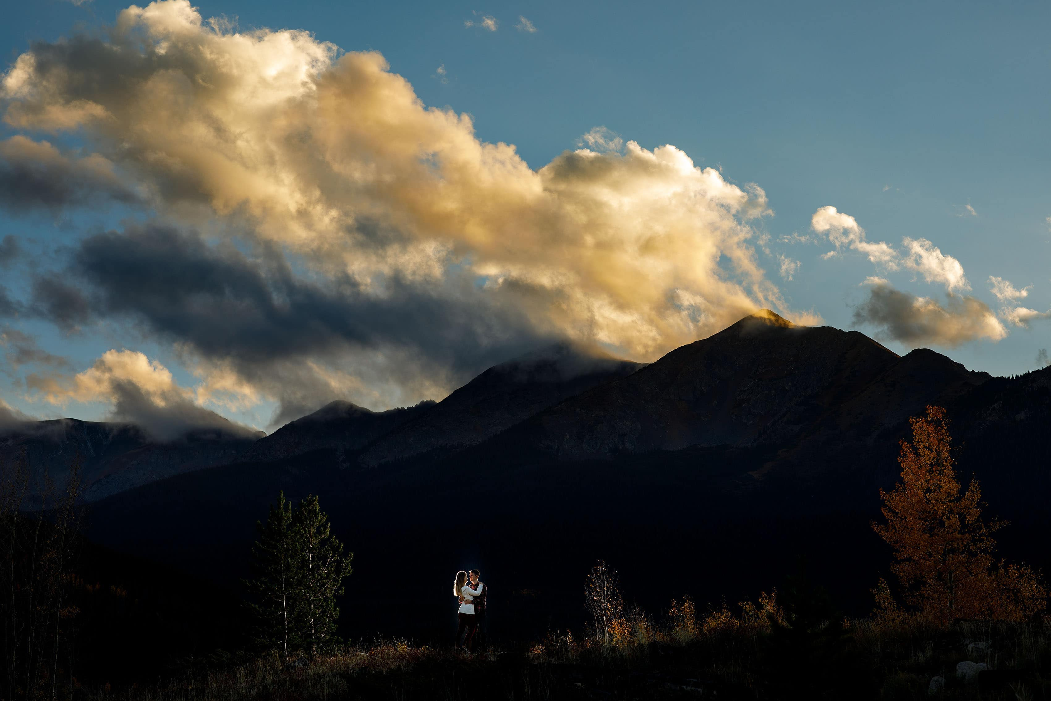 The sun sets over the mountain in Frisco Colorado during Holly and Hayden's fall mountain engagement
