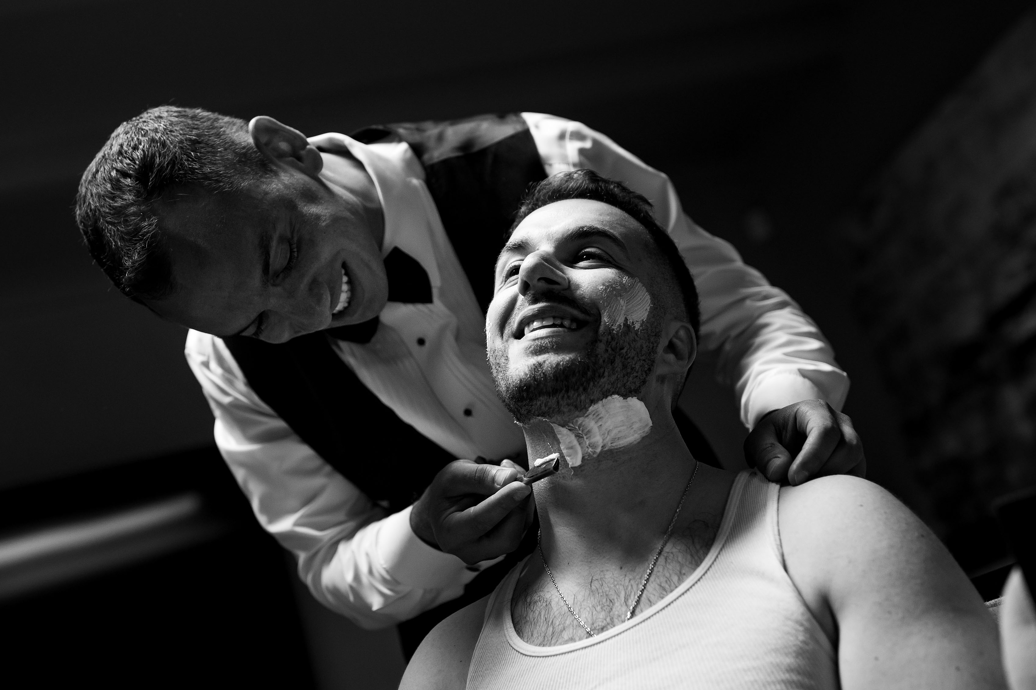 The groom is shaved by the best man during a cypriot wedding tradition prior to the Albuquerque wedding