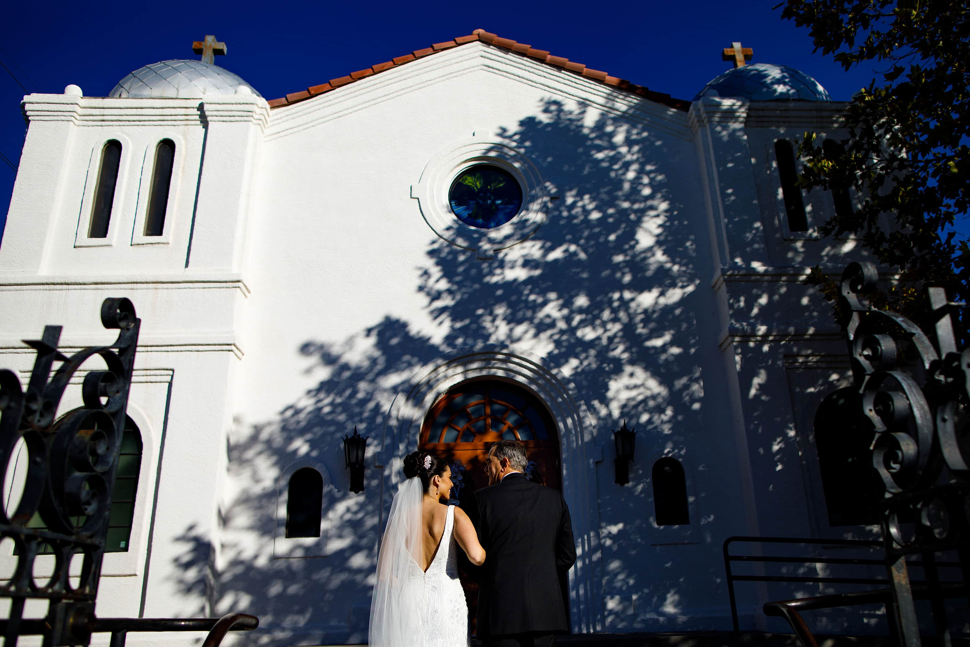 The bride stands outside Saint George Greek Orthodox Church in Albuquerque before walking down the aisle