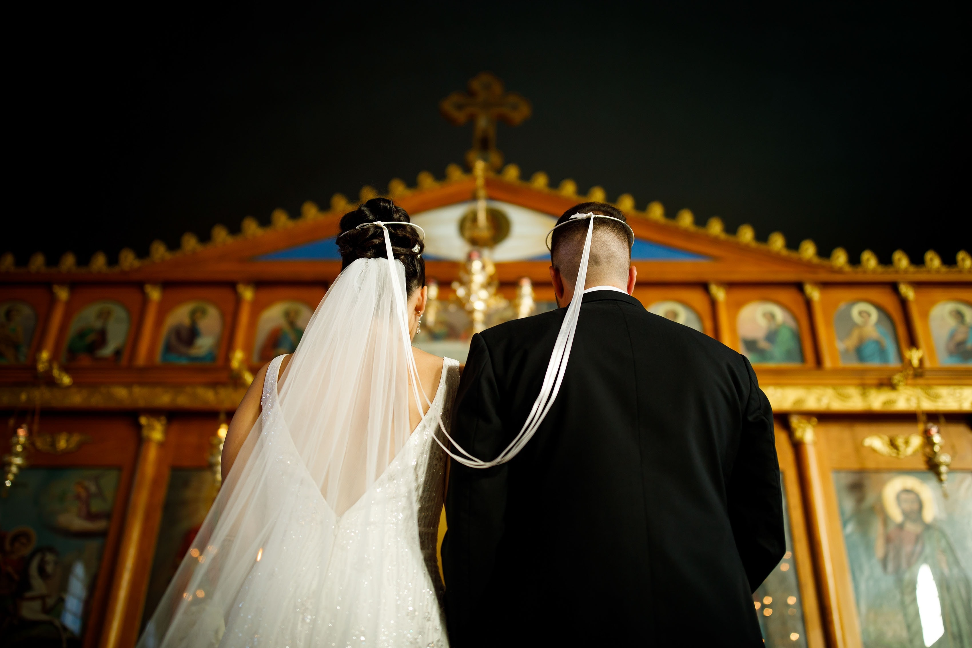 The bride and groom wear the stefana at Saint George Greek Orthodox Church in Albuquerque