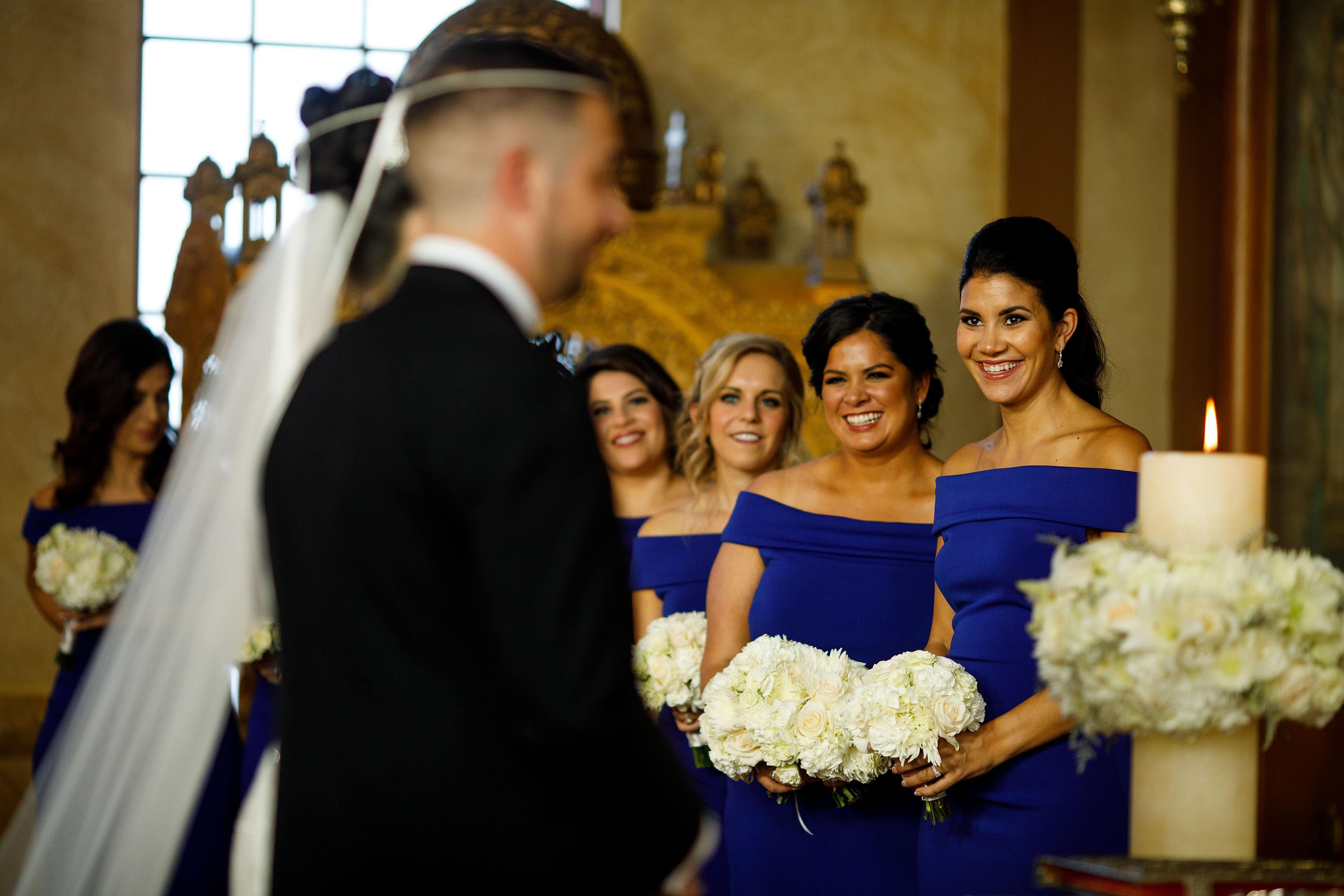 The Koumbara and bridesmaids smile during the greek wedding in Albuquerque
