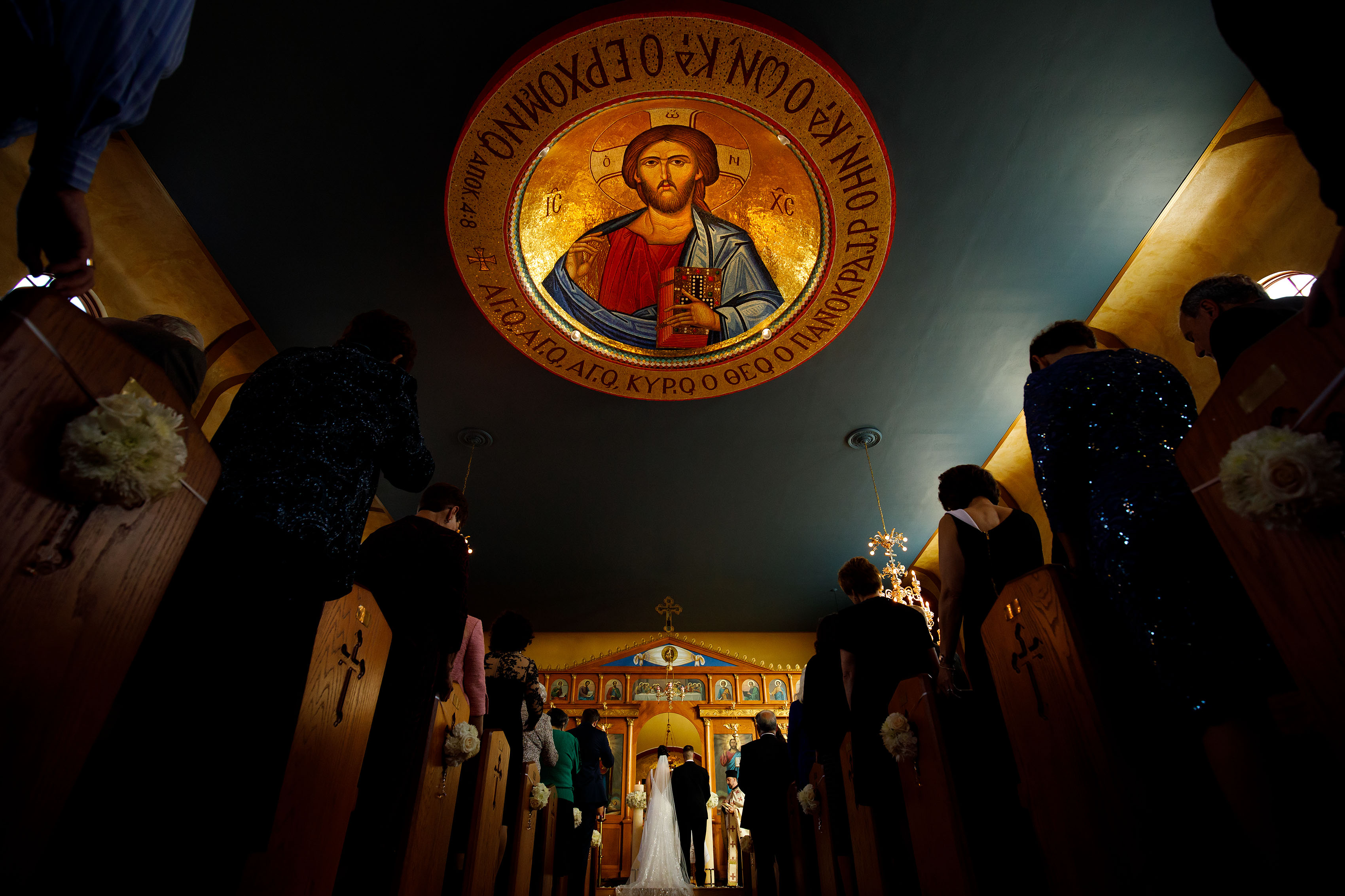 Inside Saint George Greek Orthodox Church in Albuquerque New Mexico during a wedding ceremony