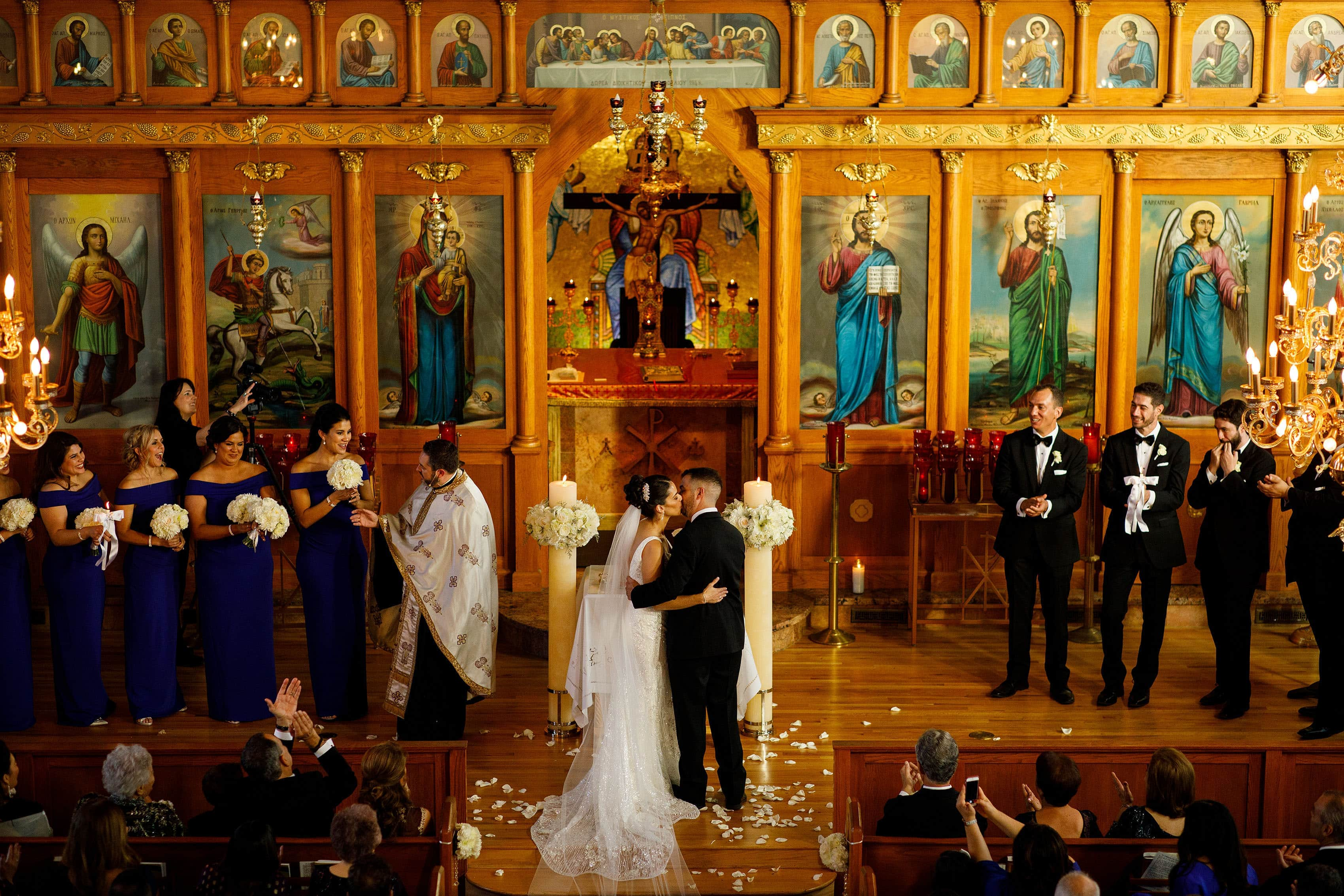 First kiss during the Albuquerque Greek Orthodox wedding at Saint George Greek Orthodox Church