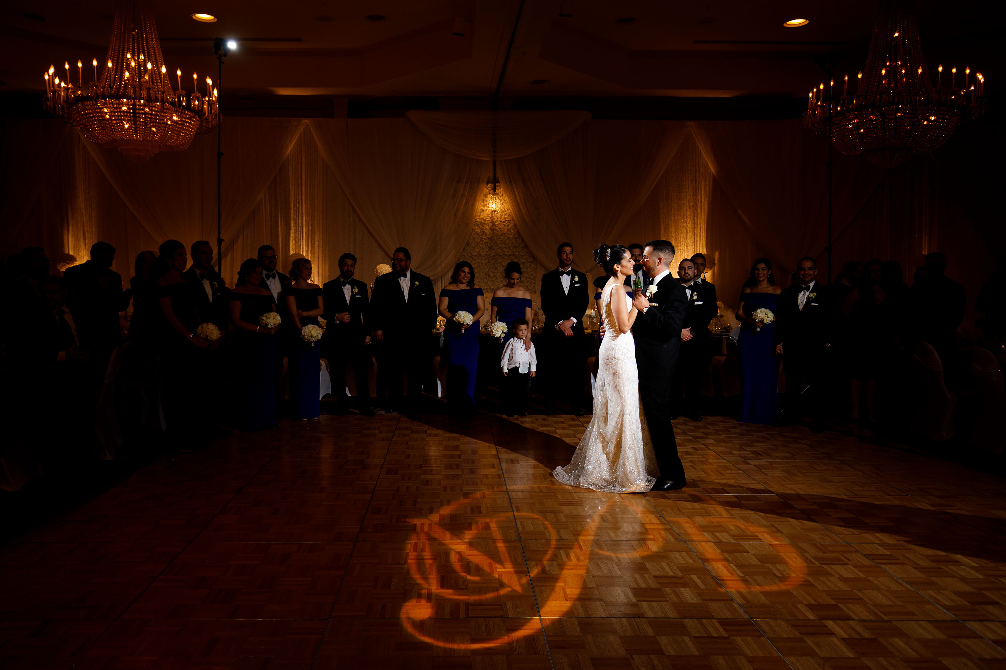 Nicole and Demetris dance together at the Sheraton Albuquerque uptown during their Greek wedding reception