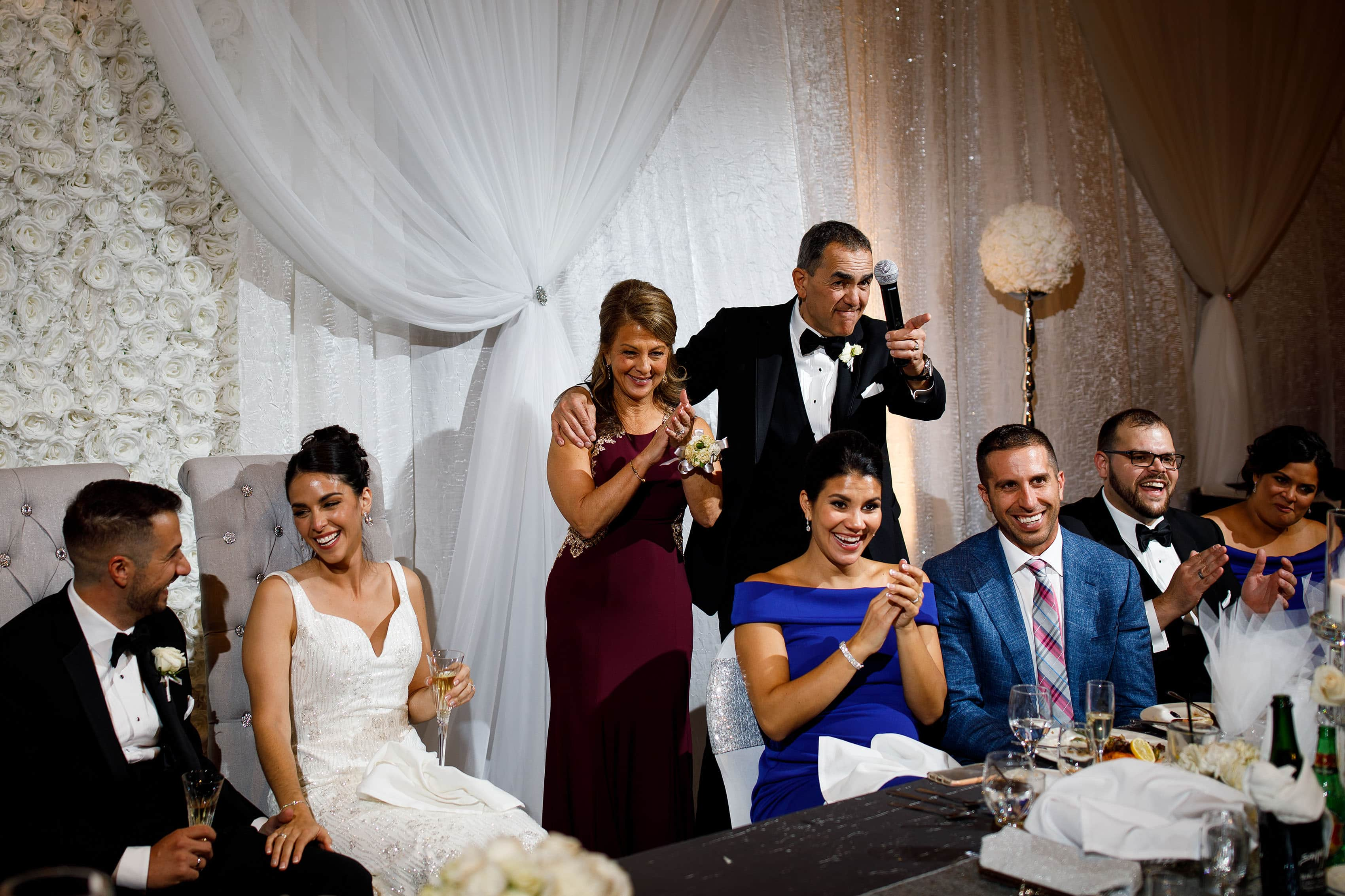 The father of the groom gives a toast during a Greek wedding at the Sheraton Albuquerque uptown