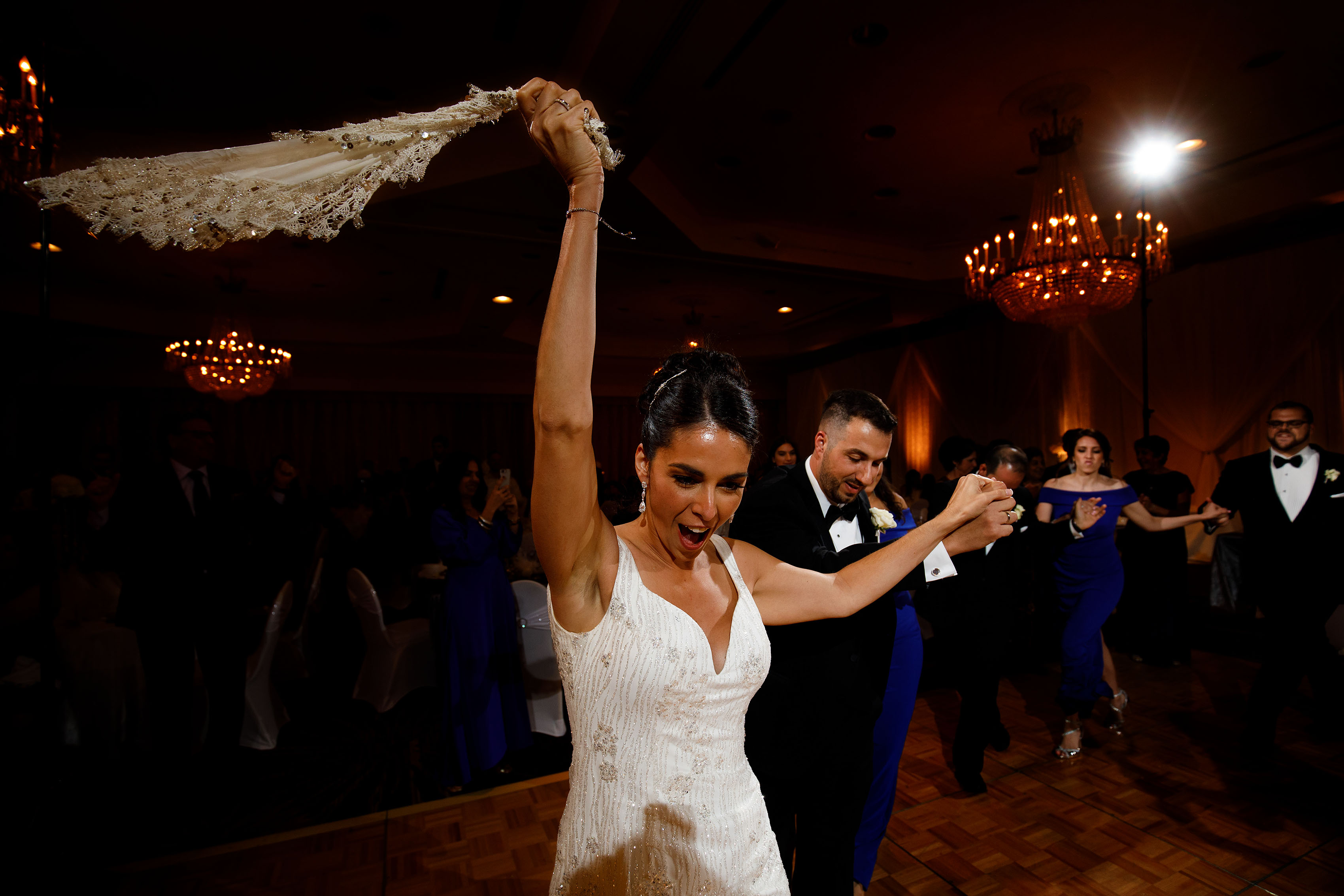 The bride leads the traditional Greek dance during her wedding at the Sheraton Albuquerque uptown