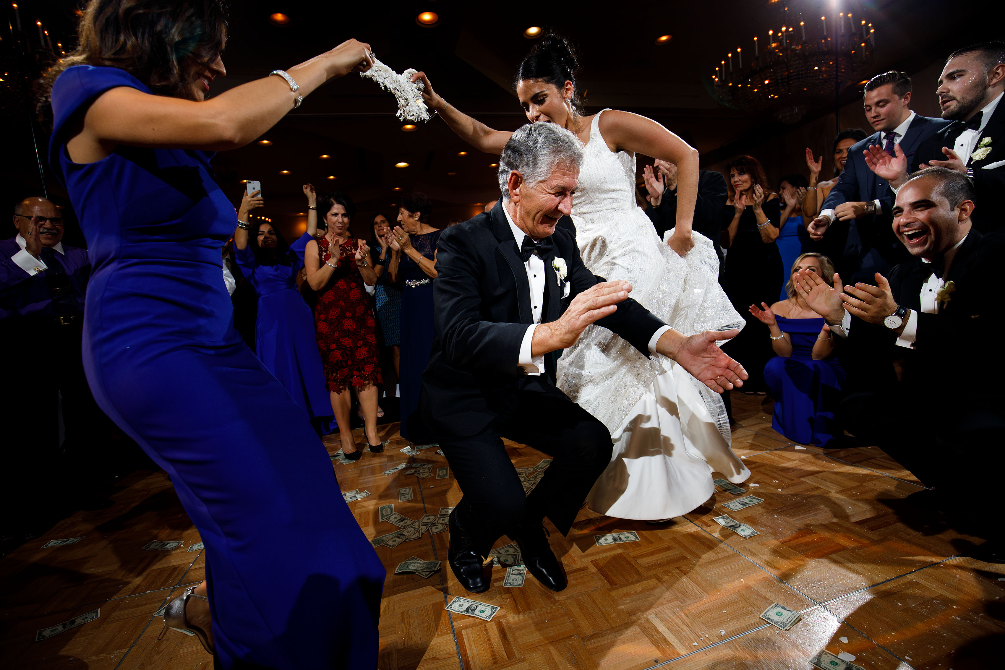 Guests dance during a traditional greek wedding at the Sheraton Albuquerque uptown