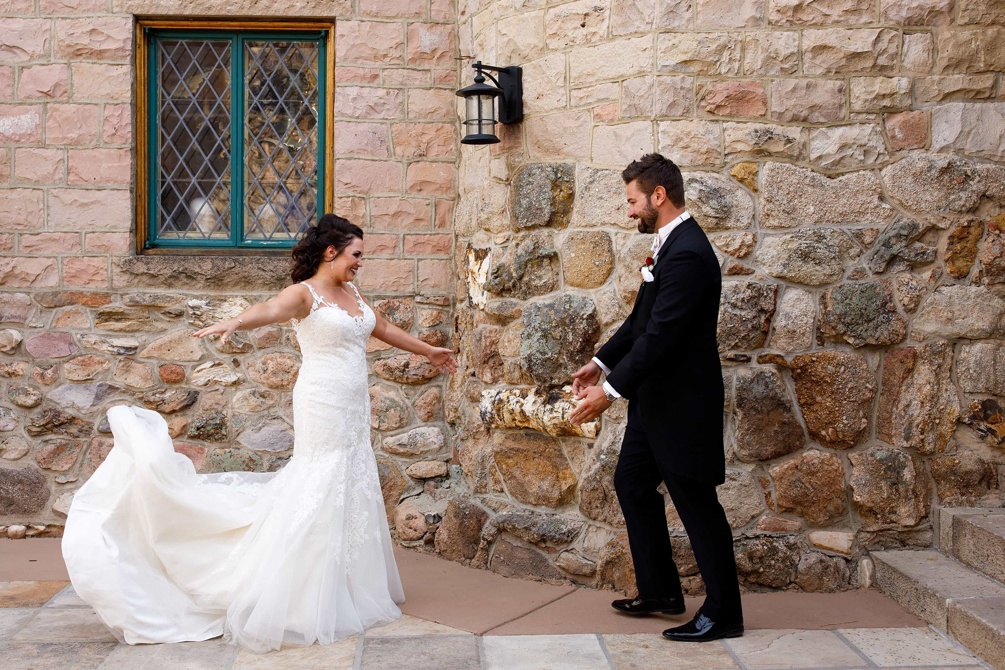 The bride and groom react during their first look before their wedding at Cherokee Ranch and Castle