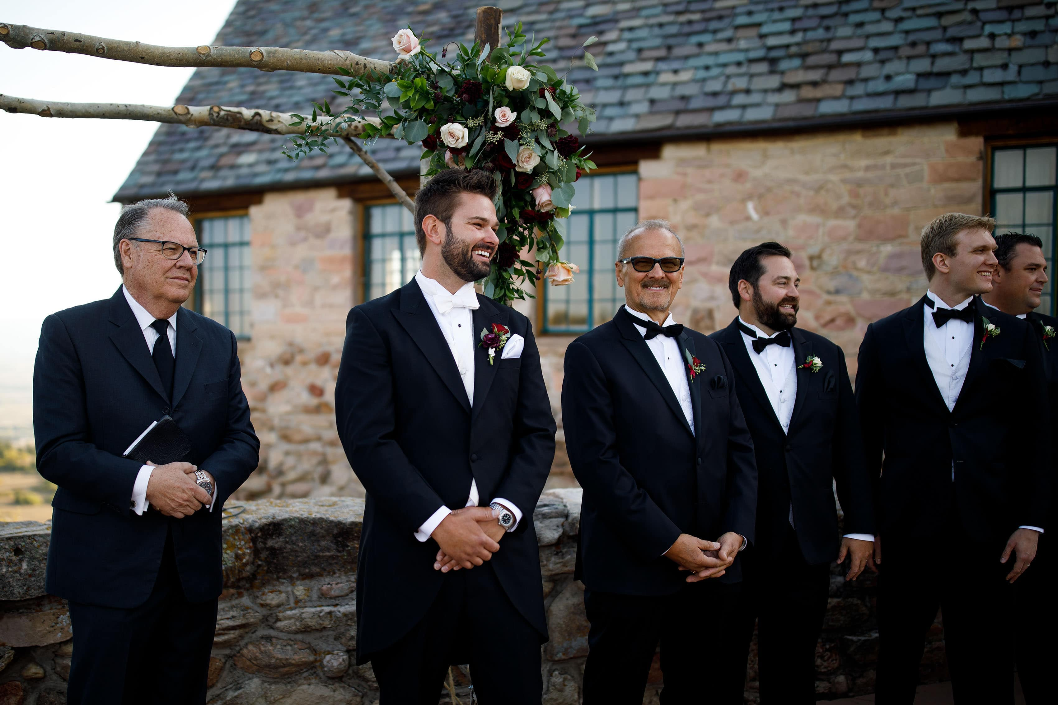 The groom smiles during the ceremony
