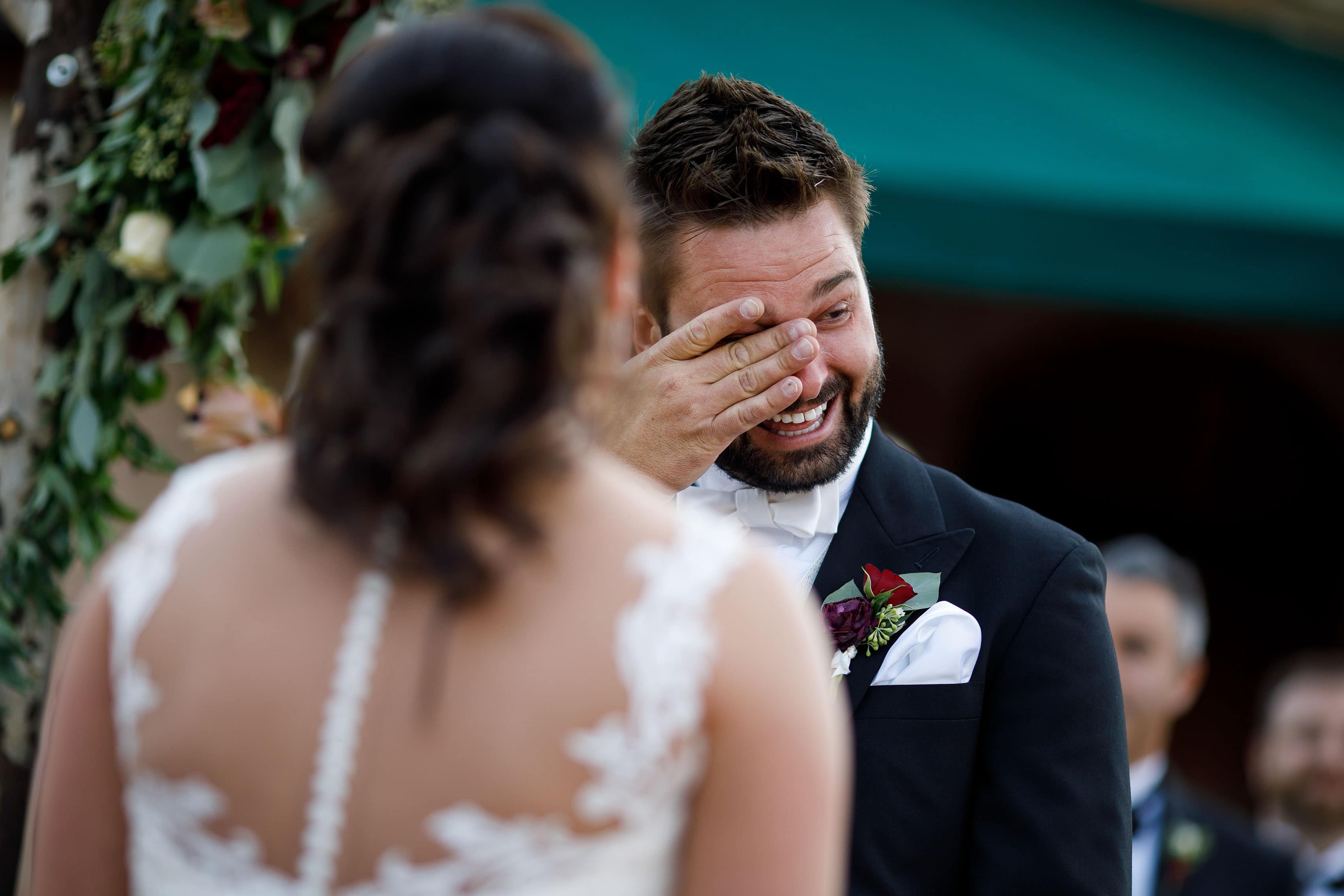 Jordan wipes away a tear during Melissa's vows