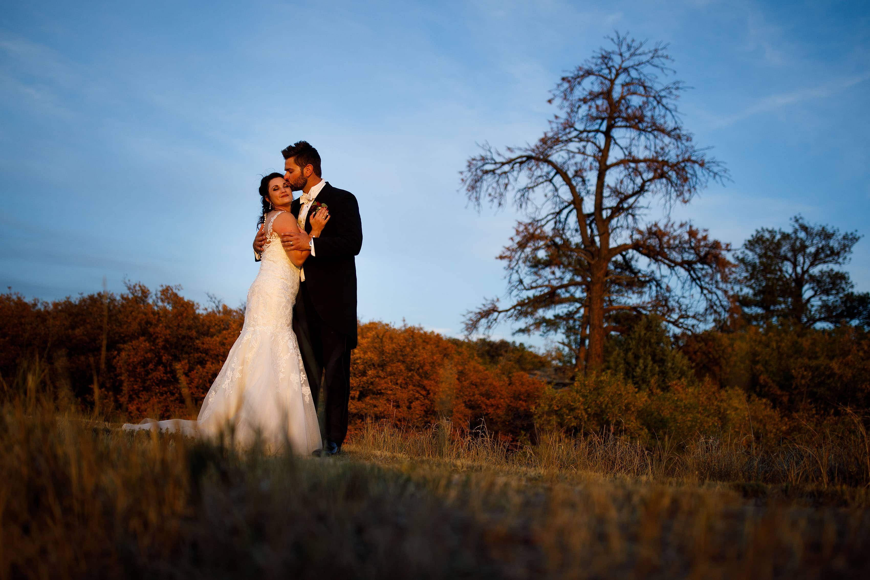The couple pose in a field near Sedalia