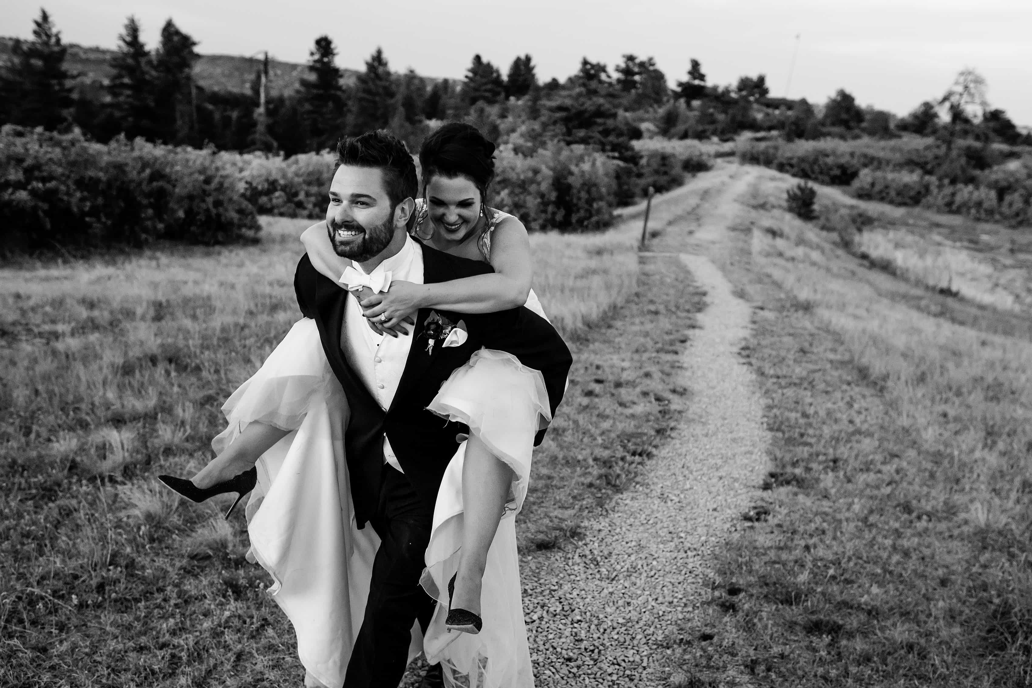 Jordan carries Melissa back to Cherokee Ranch and Castle for their wedding reception after posing for portraits