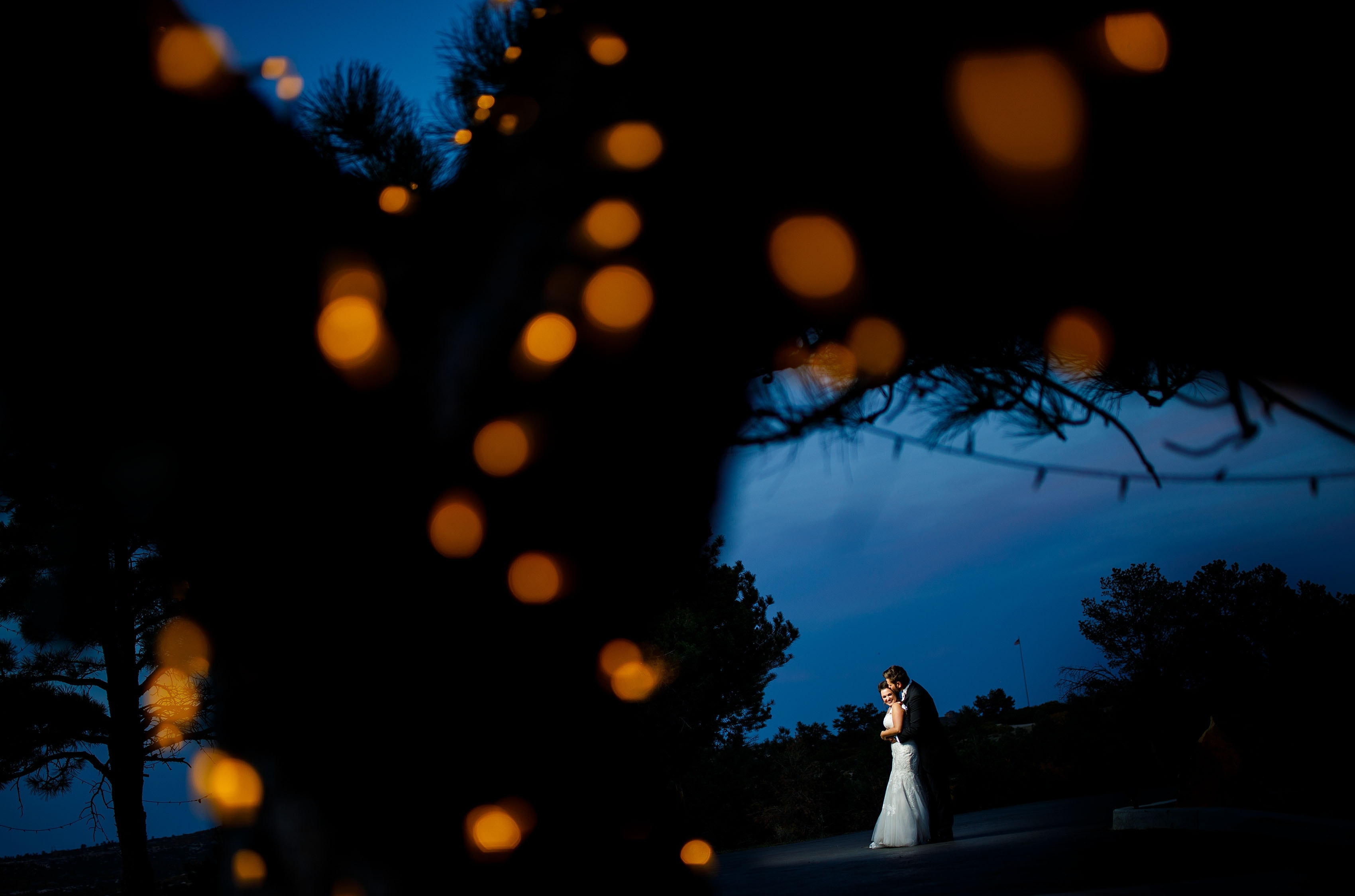 Melissa and Jordan pose together at dusk in Sedalia during their Cherokee Ranch and Castle wedding