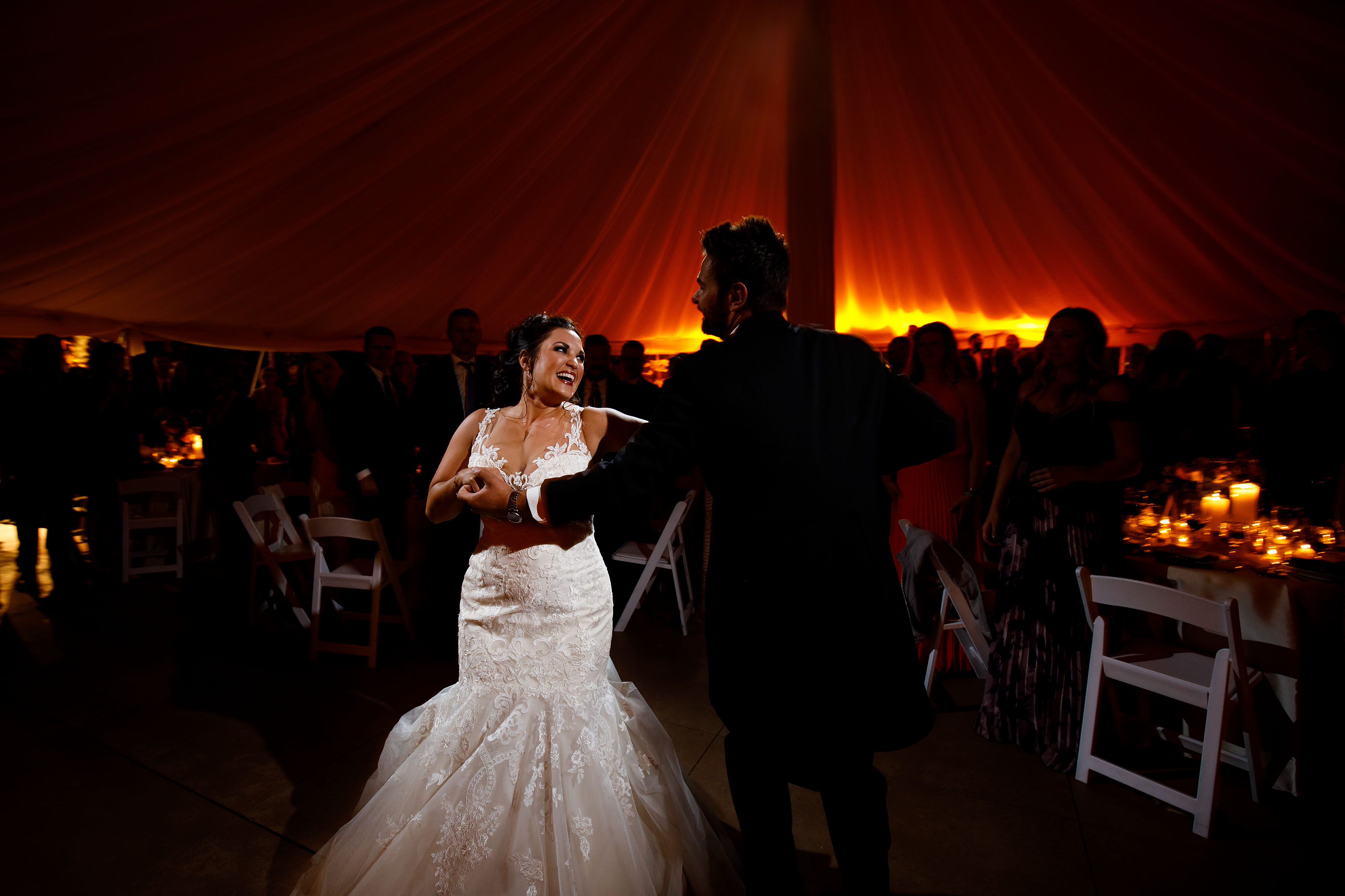 Melissa smiles at Jordan during their first dance at Cherokee Ranch and Castle