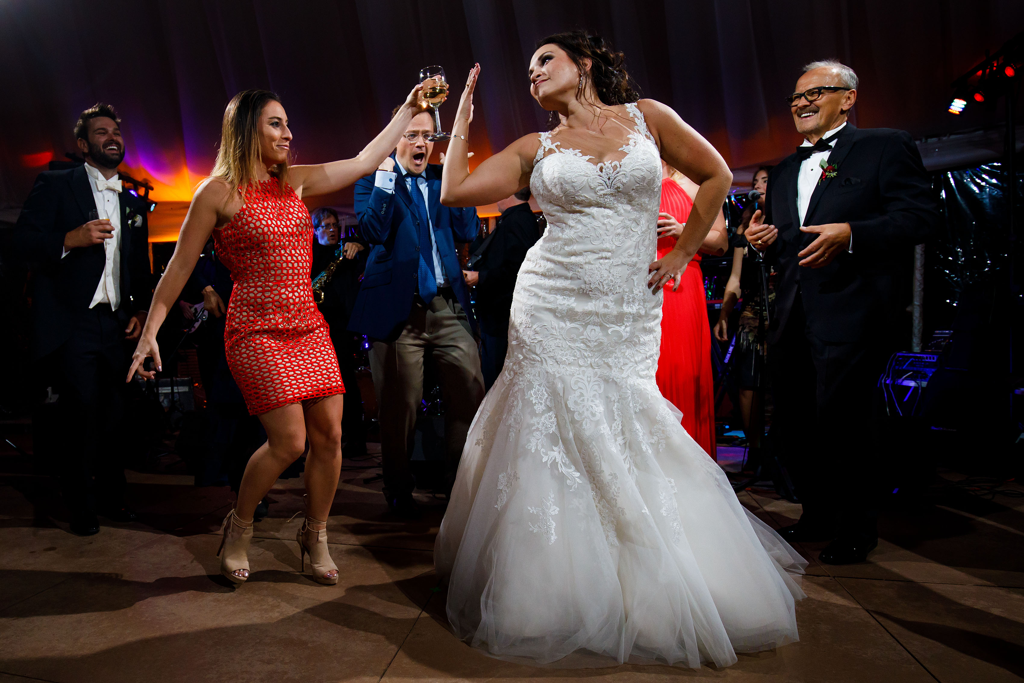 Melissa dances with guests during her fall wedding in Sedalia