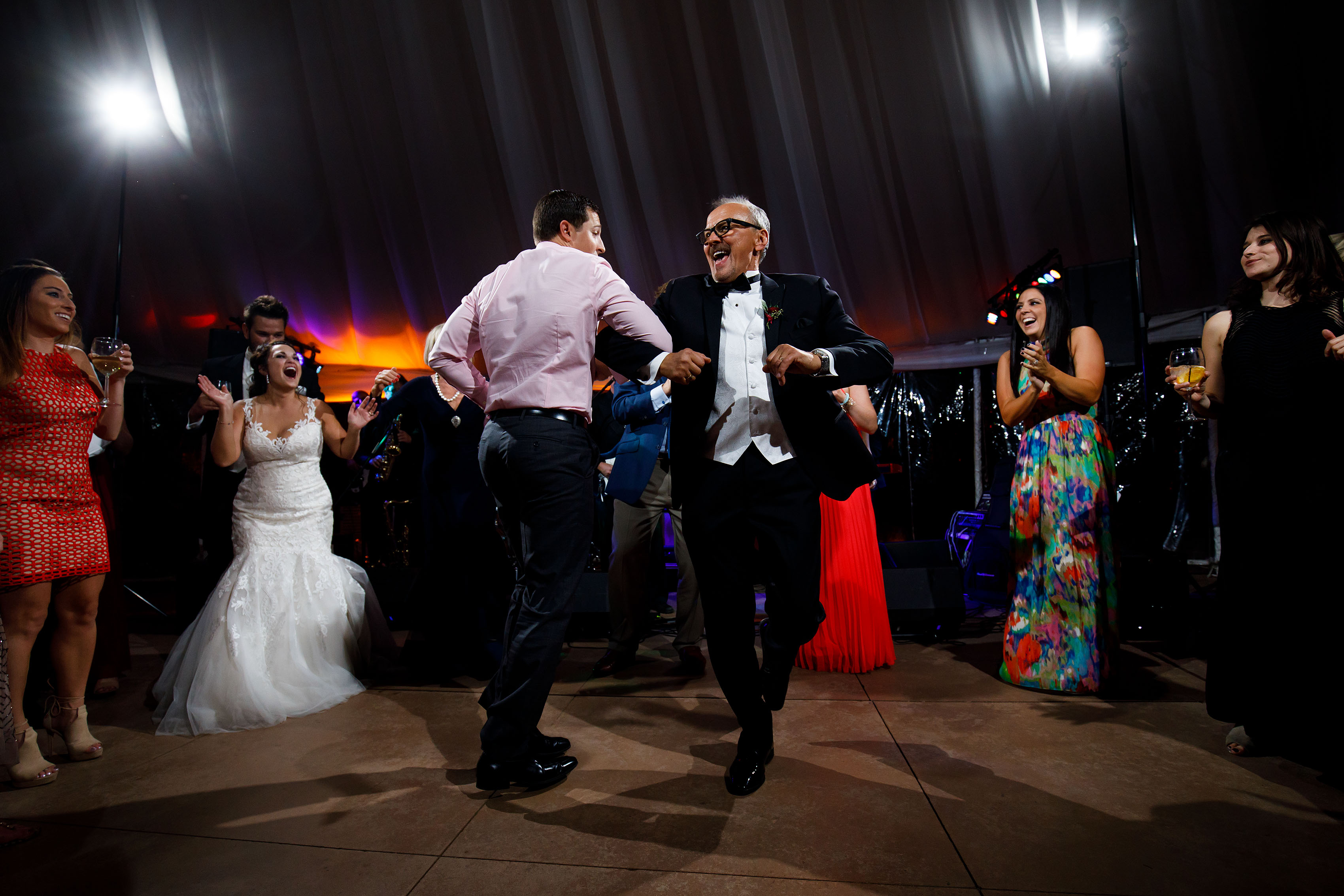 Guests dance together at Melissa and Jordan's wedding