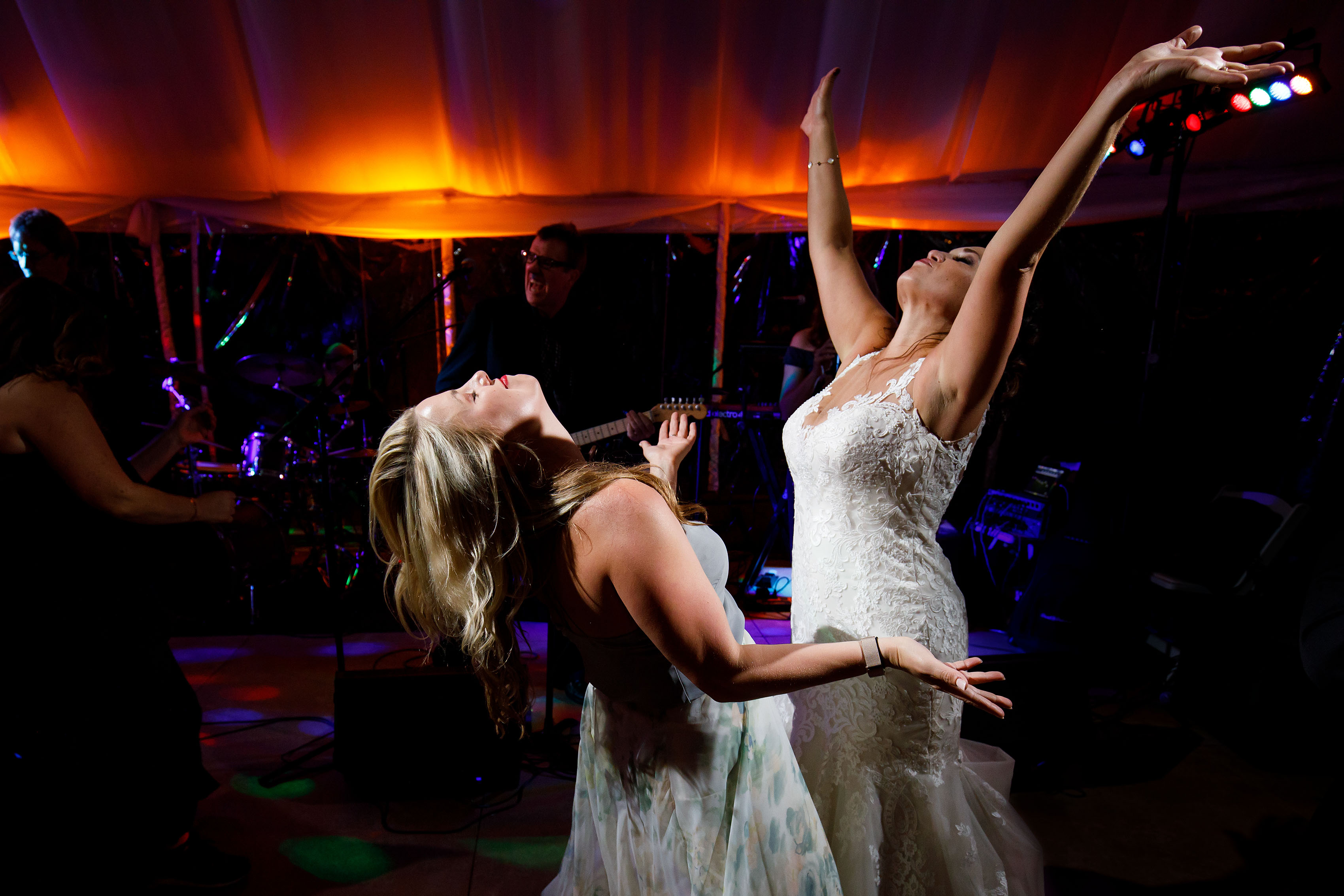 Melissa dances with Cara during the wedding in Sedalia
