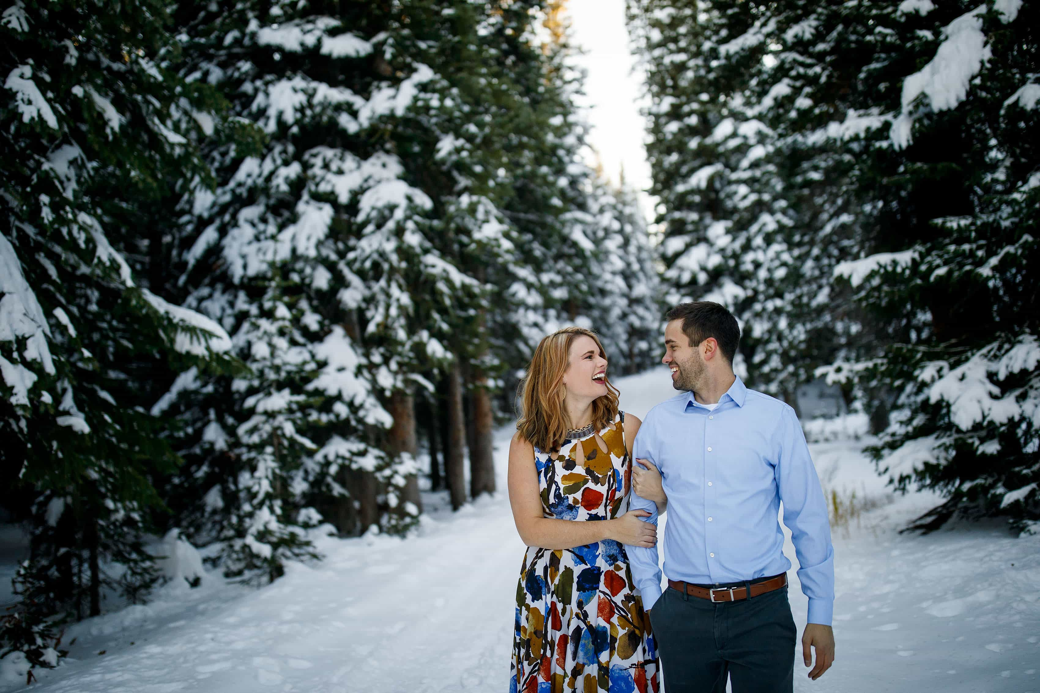 Jula and Micha walk together near snow covered evergreen trees in Vail atop Shrine Pass