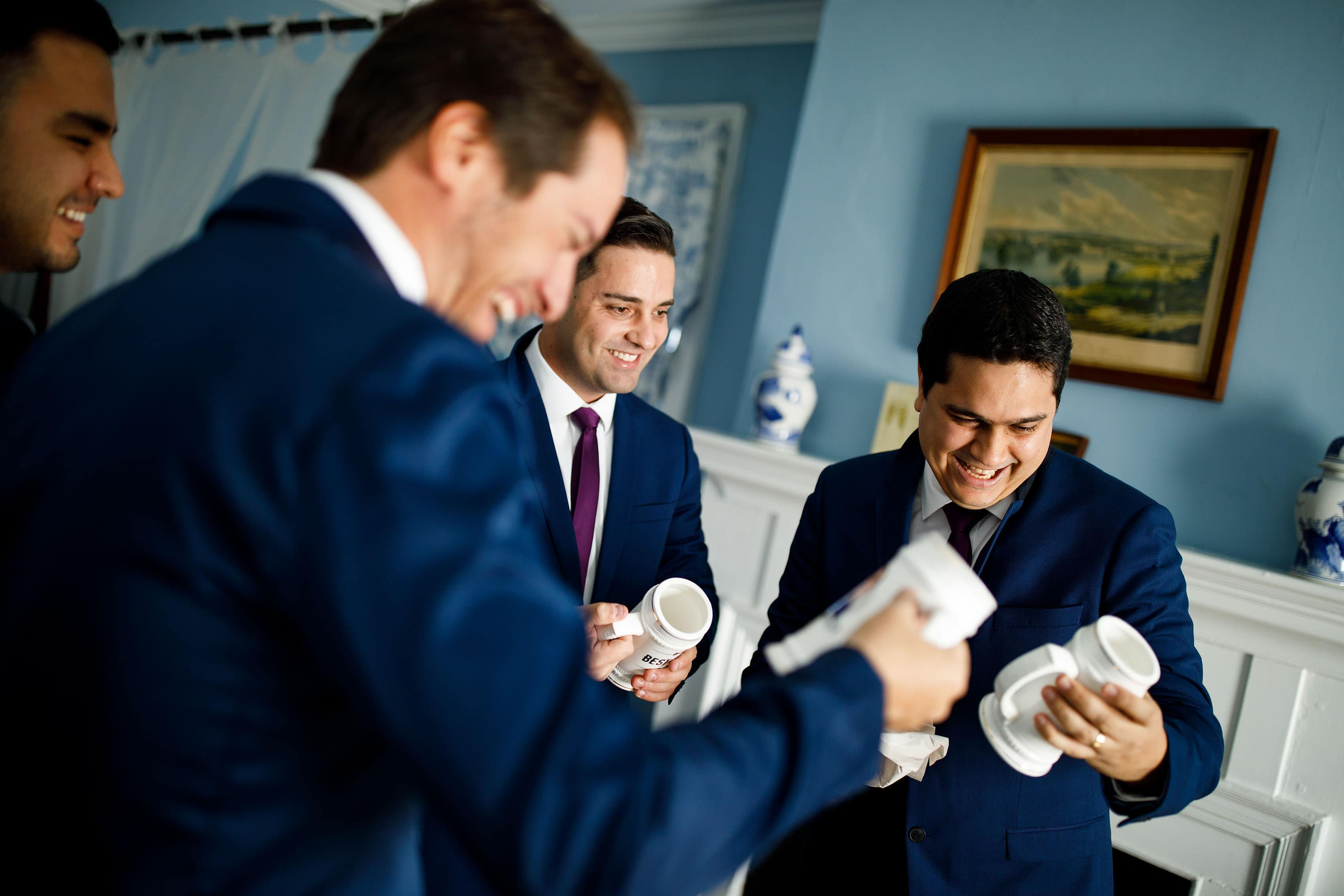 The groomsmen share a laugh together before the wedding in Orange