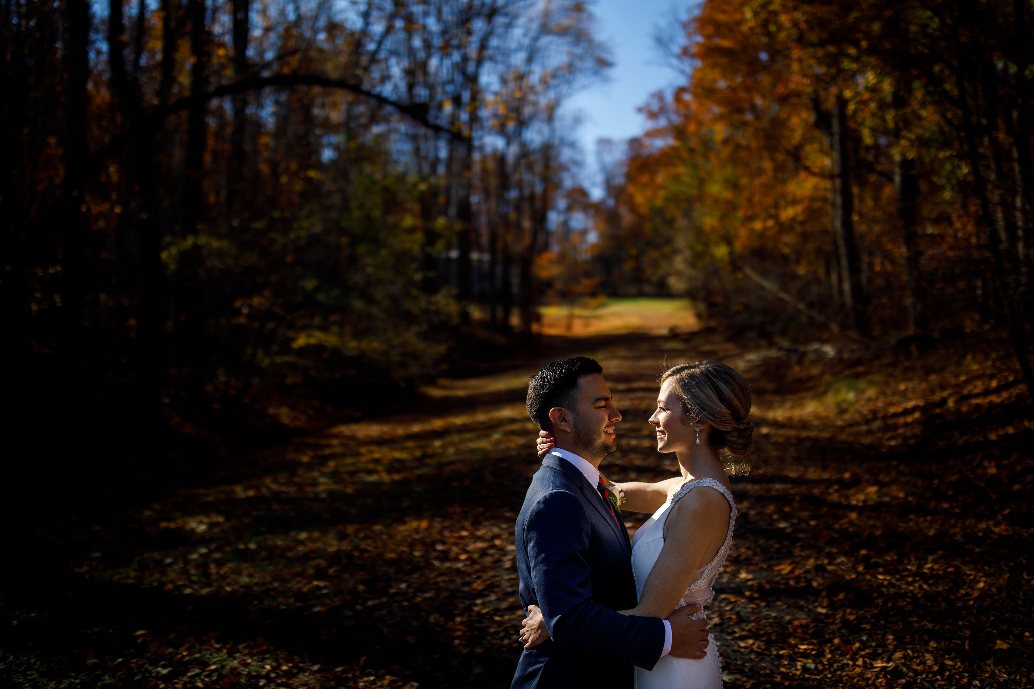 Ashley and Richie share a moment together neara grove of trees during their fall wedding in Orange, Virginia at madison on the Mill