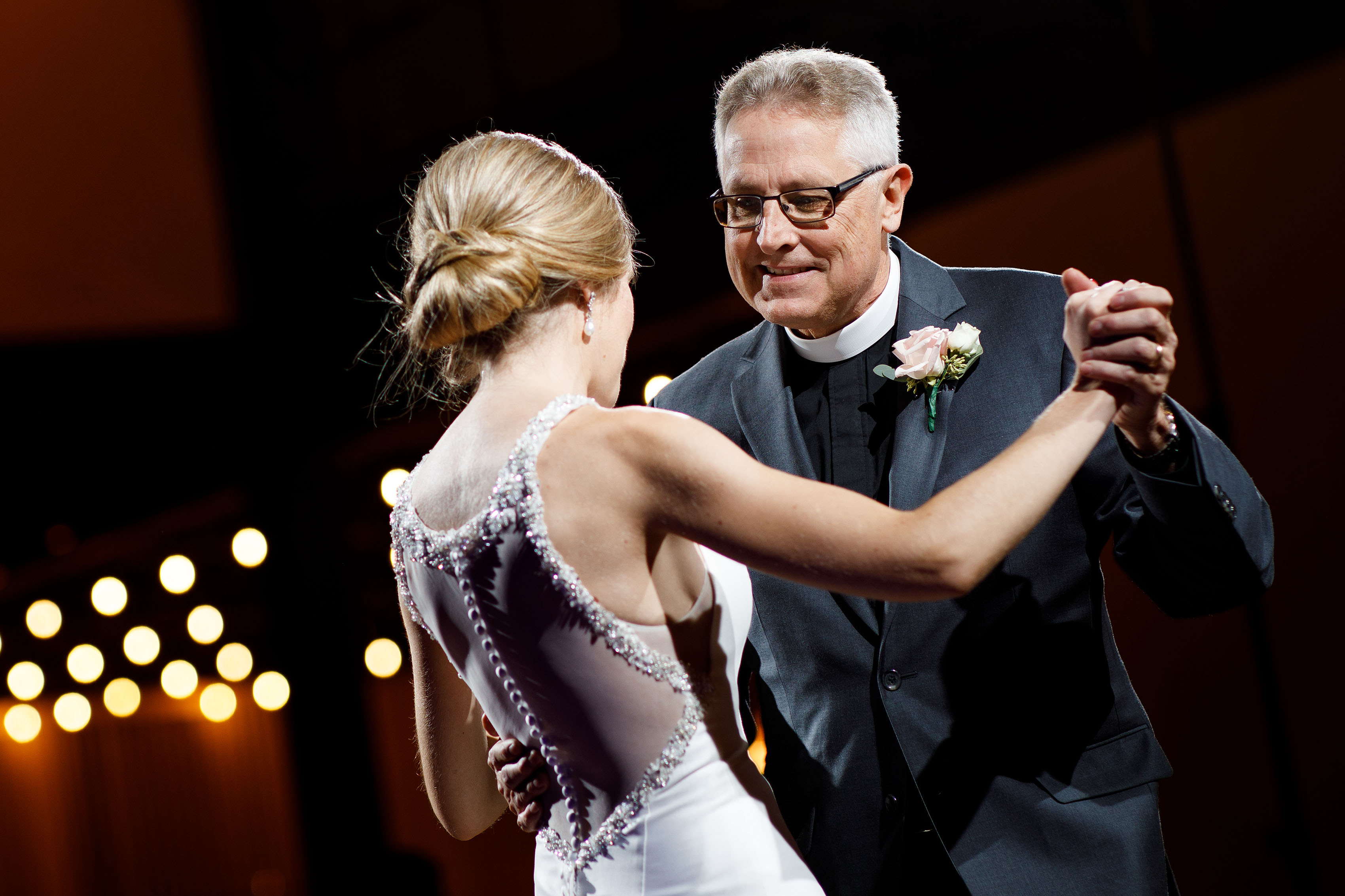 Ashley dances with her father during her wedding in Orange